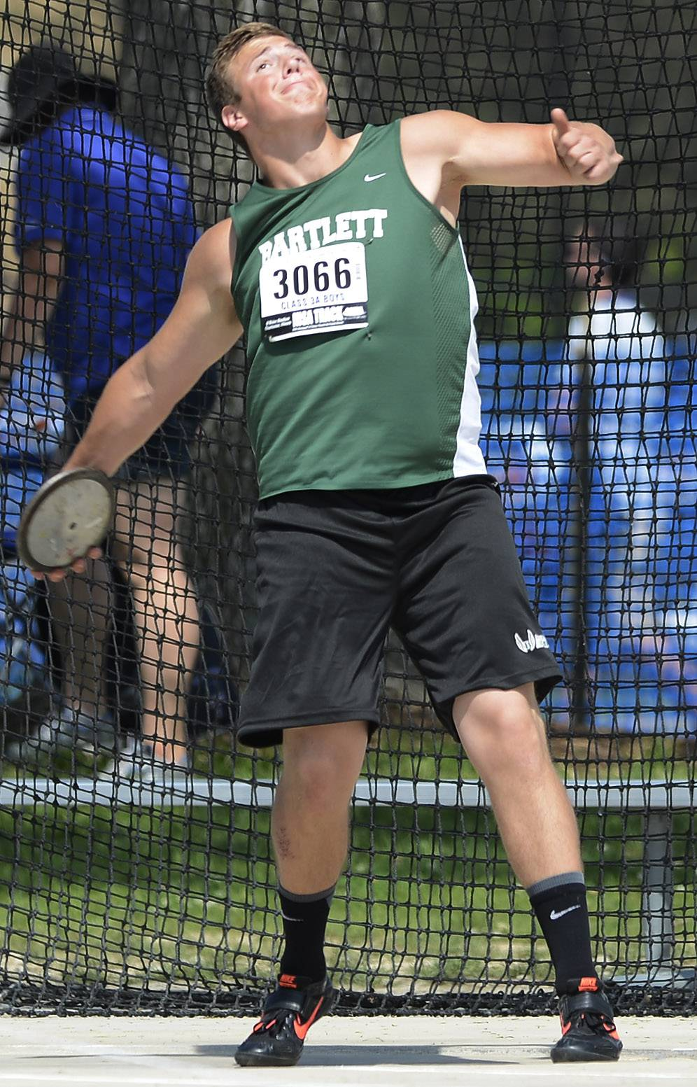 Bartlett's Dan Danek throws the discus during the boys Class 3A state track and field preliminaries in Charleston Friday.