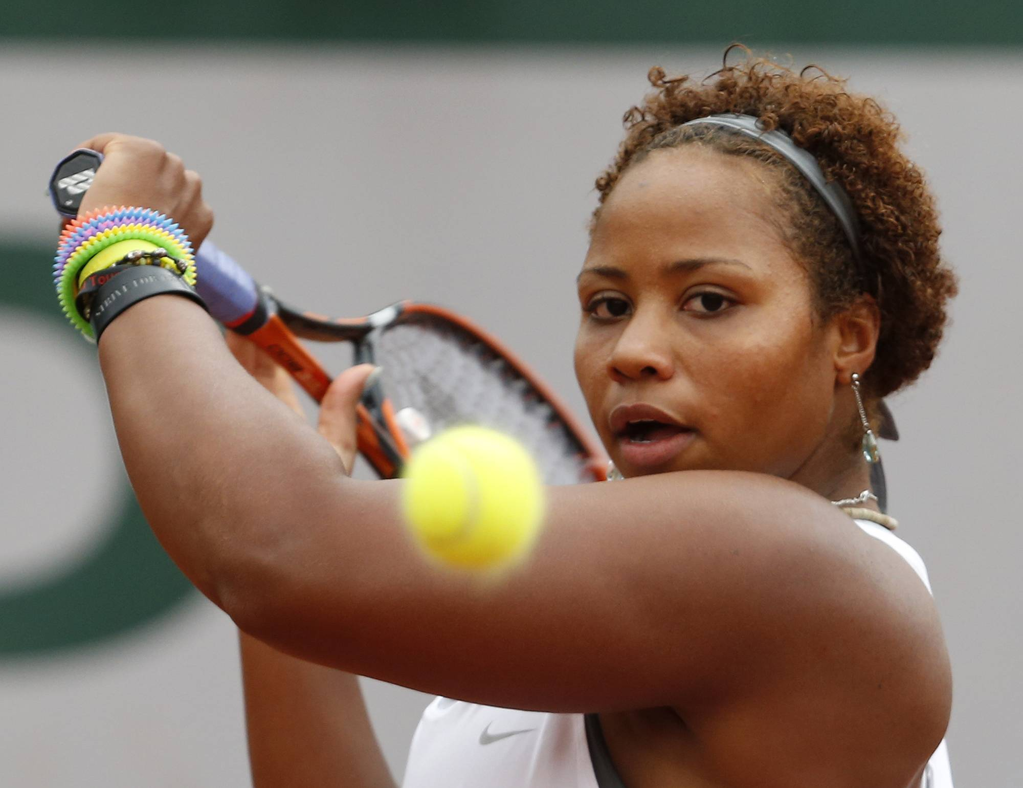 Taylor Townsend, of the U.S, returns the ball to France's Alize Cornet during the second round match of  the French Open tennis tournament at the Roland Garros stadium, in Paris, France, Wednesday, May 28, 2014.