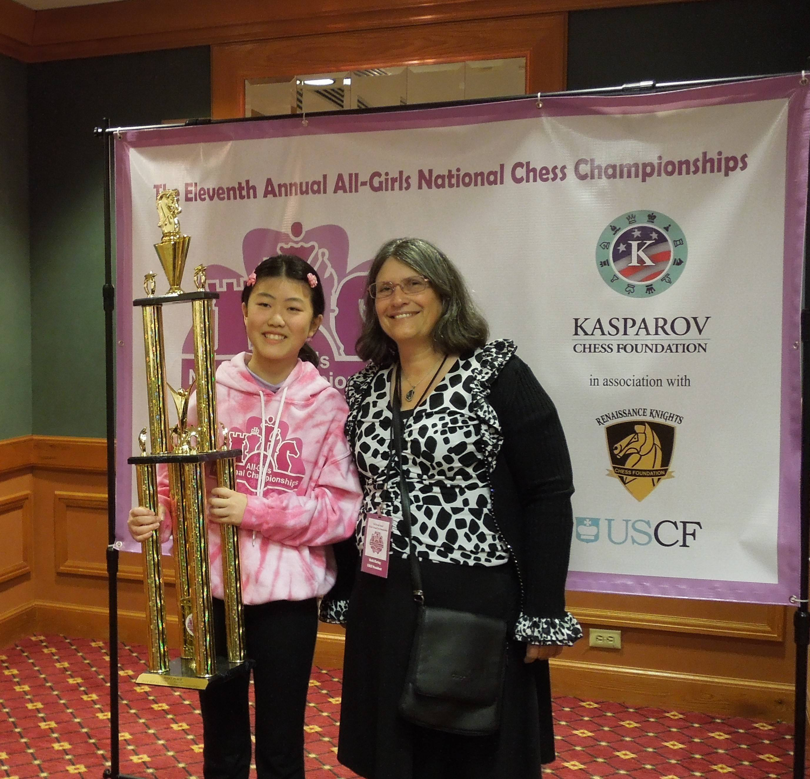 Marissa Li, left, proudly displays her trophy alongside United States Chess Federation President Ruth Haring.