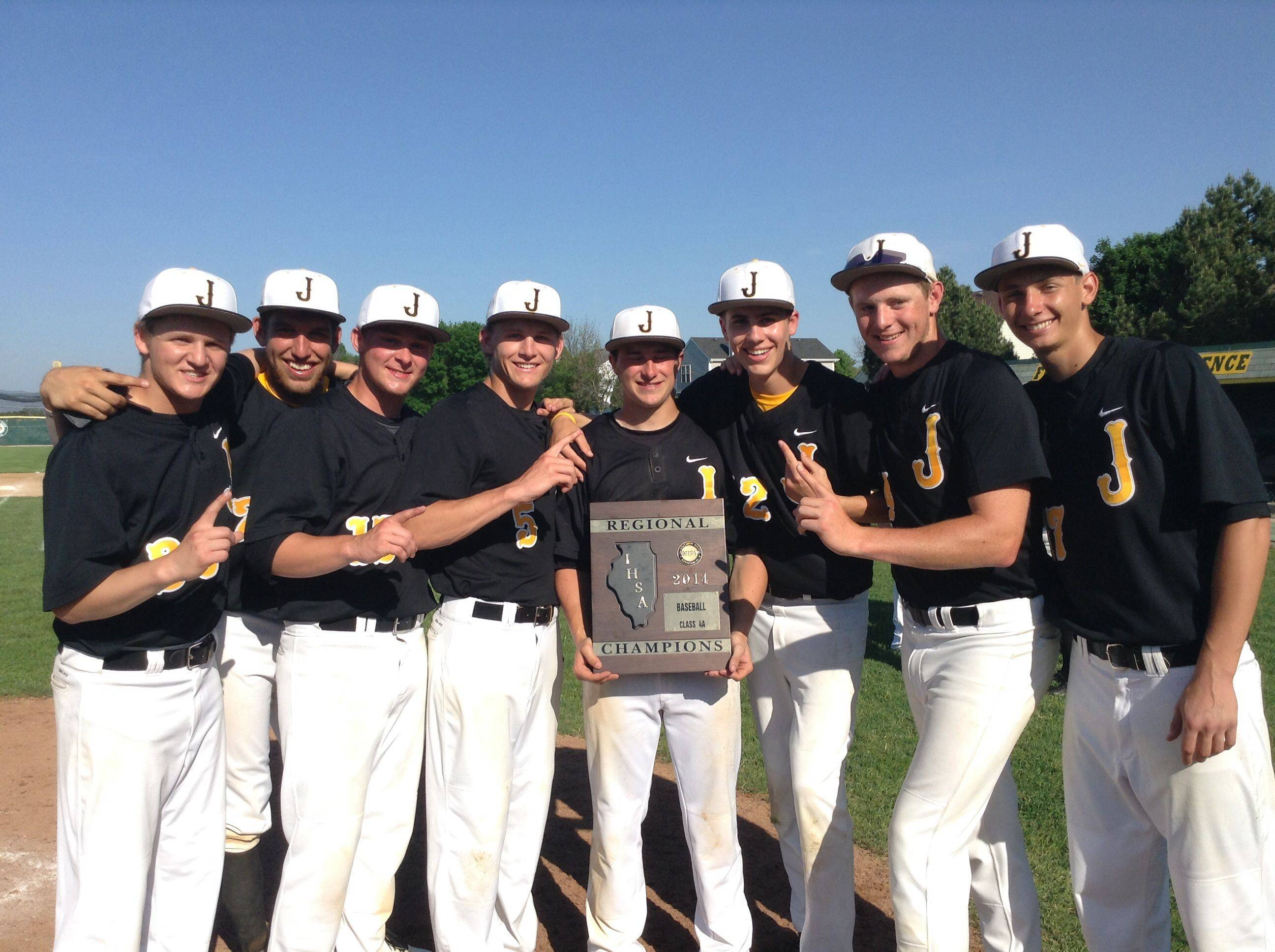 The Jacobs baseball team displays the Class 4A regional championship plaque it won at Crystal Lake South on Saturday.