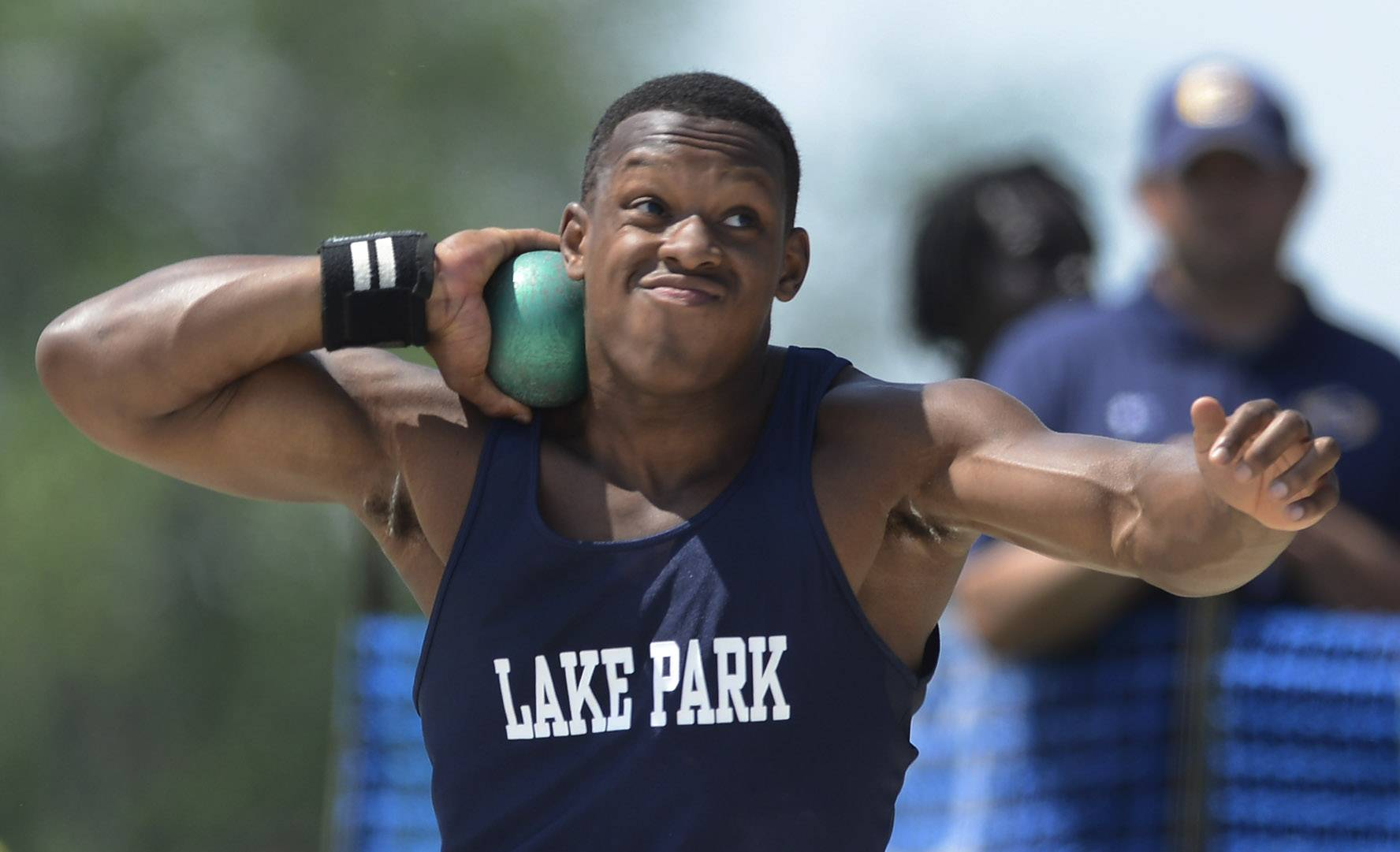 Lake Park's Curtwan Evans makes his throw on the shot put during the boys class 3A state track and field finals in Charleston Saturday