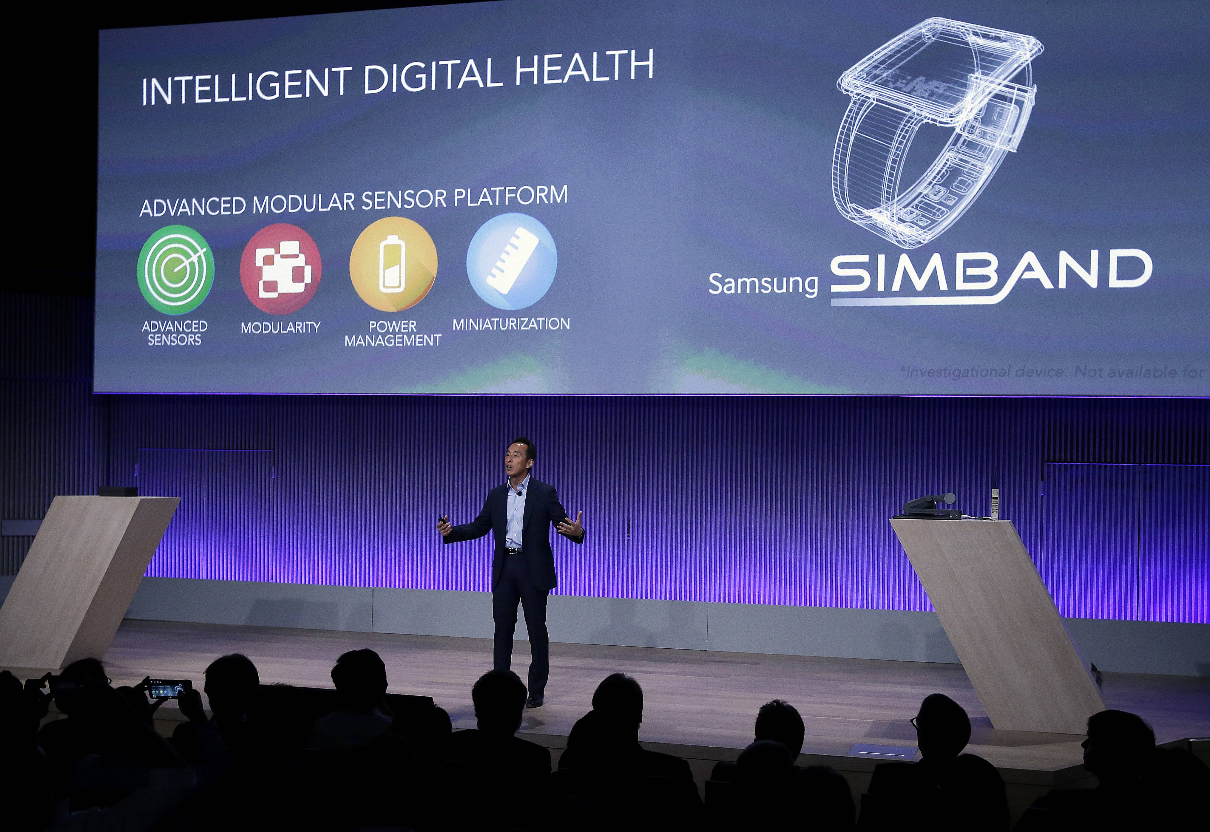 Young Sohn, president and chief strategy officer for Samsung Electronics, speaks Wednesday in San Francisco. Samsung executives are outlining their vision for sensors that track fitness and other gauges of health. Samsung is pushing for a common system so that different manufacturers can interchange key parts such as the wristband. The company believes that will speed innovation and get products to market more quickly.