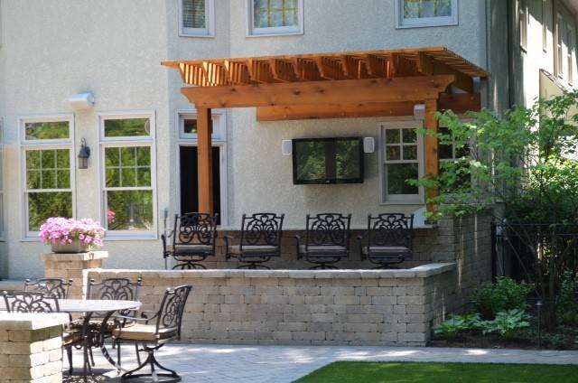 Popular features like pergolas, outdoor kitchens and retaining walls can all be incorporated into your outdoor design.