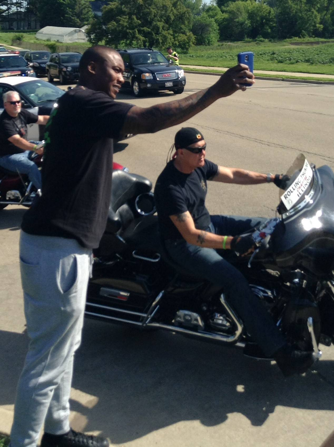 Bears wide receiver Brandon Marshall cheers on motorcyclists at the beginning of Saturday's ride from Naperville to Ottawa. He tweeted photos throughout the event.