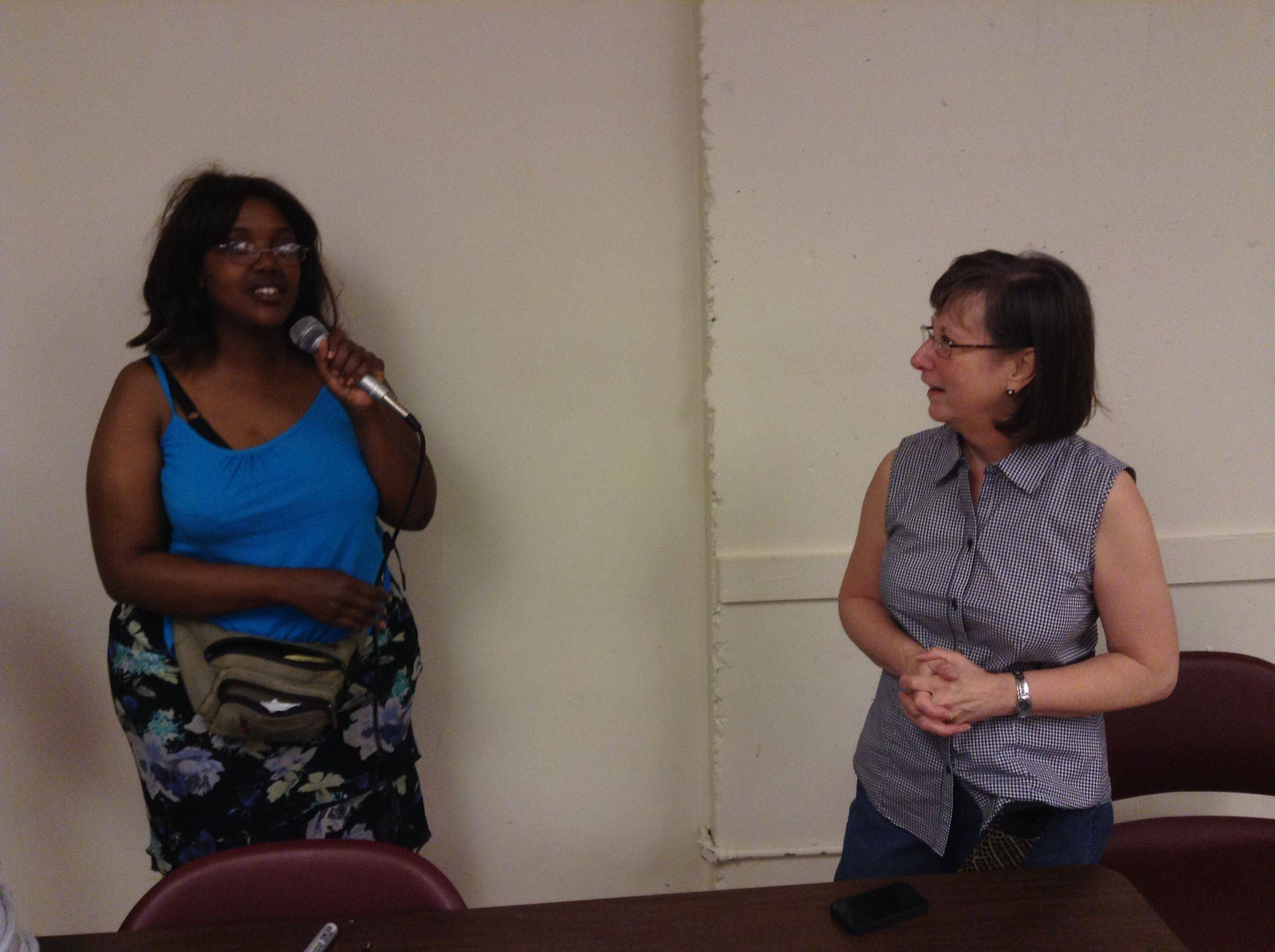 Dena Martinez, left, of Mundelein speaks with Laura Zickuhr, one of the directors of Emmaus House.