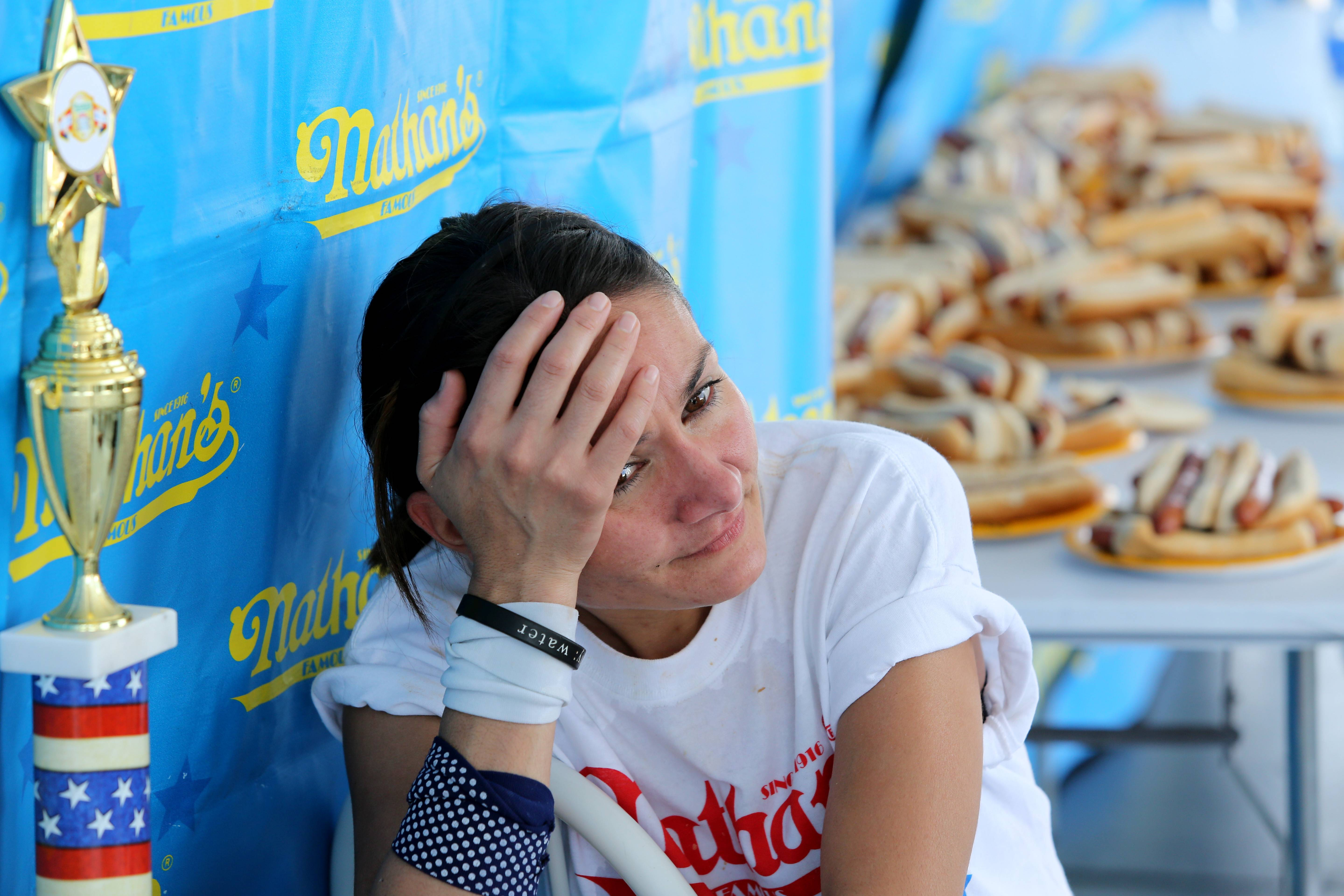 Michelle Lesco of Tucson, Arizona, reflects on her first-place win during a hot dog-eating contest in the Bloomingdale Kmart parking lot.