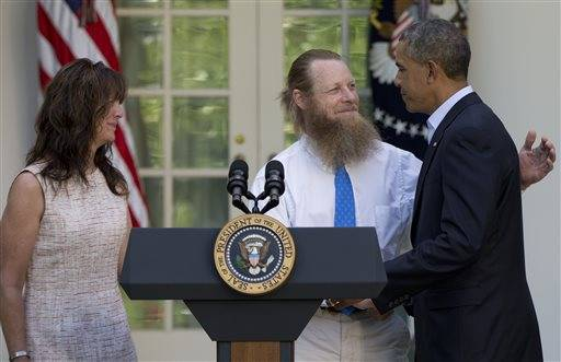 Jani Bergdahl, left, with her husband Bob Bergdahl, right, embraces President Barack Obama after he spoke about the release of their son, U.S. Army Sgt. Bowe Bergdahl, in the Rose Garden of the White House in Washington, Saturday, May 31, 2014, after the announcement that their son has been released from captivity in Afghanistan. Bergdahl, 28, had been held prisoner by the Taliban since June 30, 2009. He was handed over to U.S. special forces by the Taliban in exchange for the release of five Afghan detainees held by the United States.