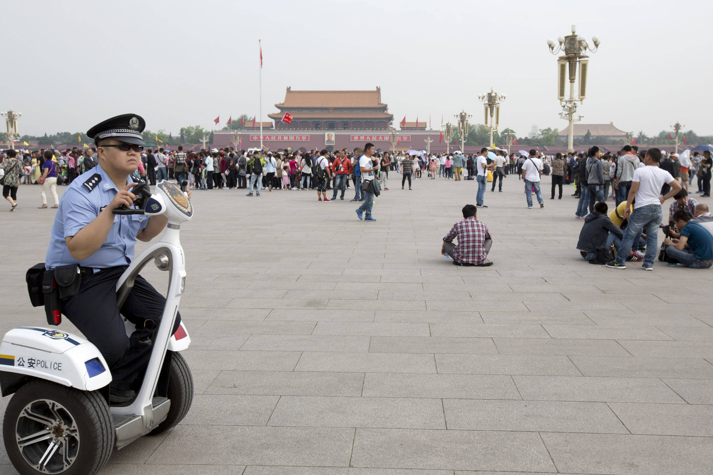 A policeman patrols on an electric personal transporter on Tiananmen Square in Beijing. A quarter century after the TiananmenSquare pro-democracy movement's suppression, China's communist authorities oversee a raft of measures for muzzling dissent and preventing protests.