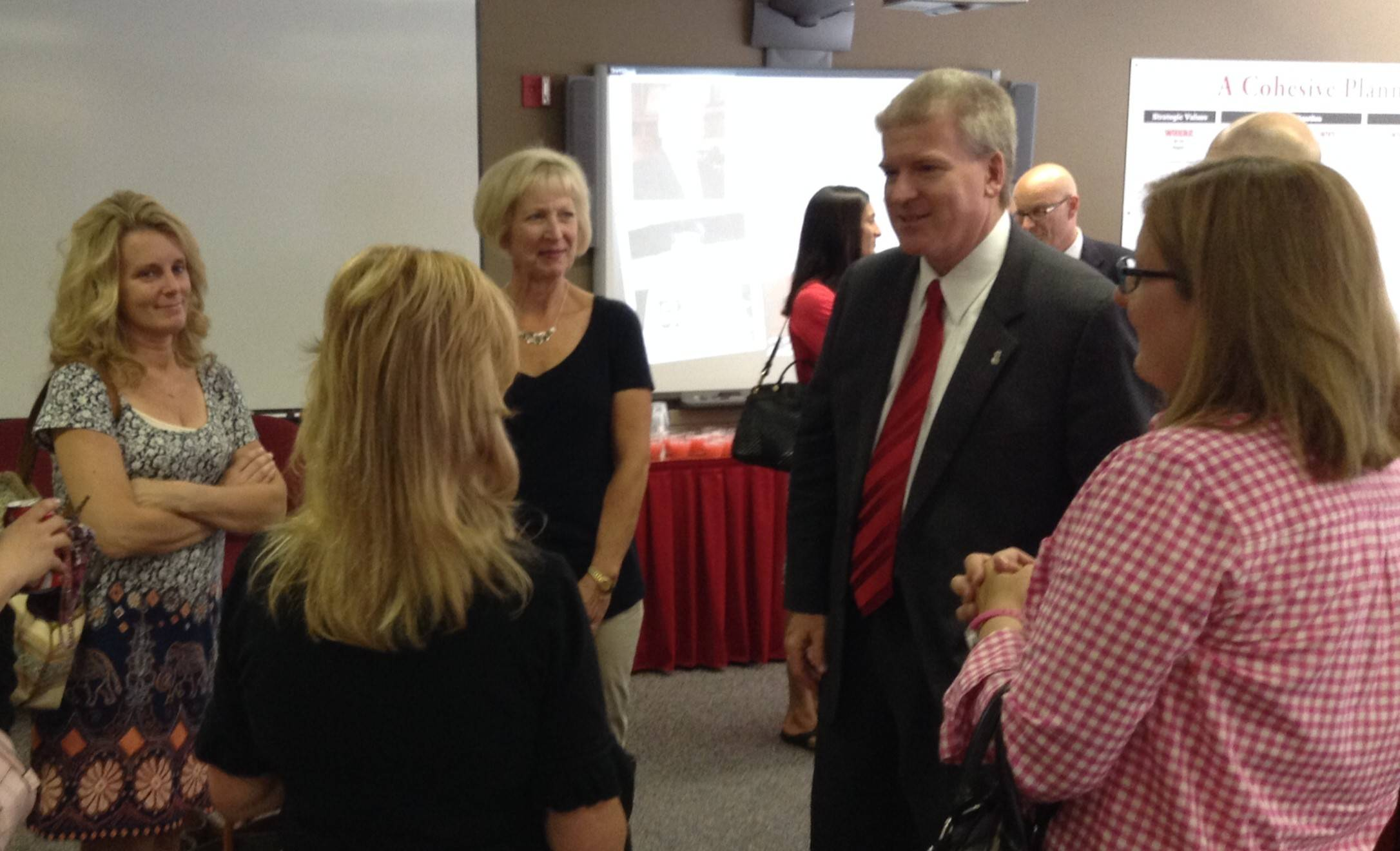 Newly appointed Barrington Area Unit District 220 Superintendent Brian Harris meets with several of the district's PTO presidents Friday, the day after he was named to succeed the departing Tom Leonard.