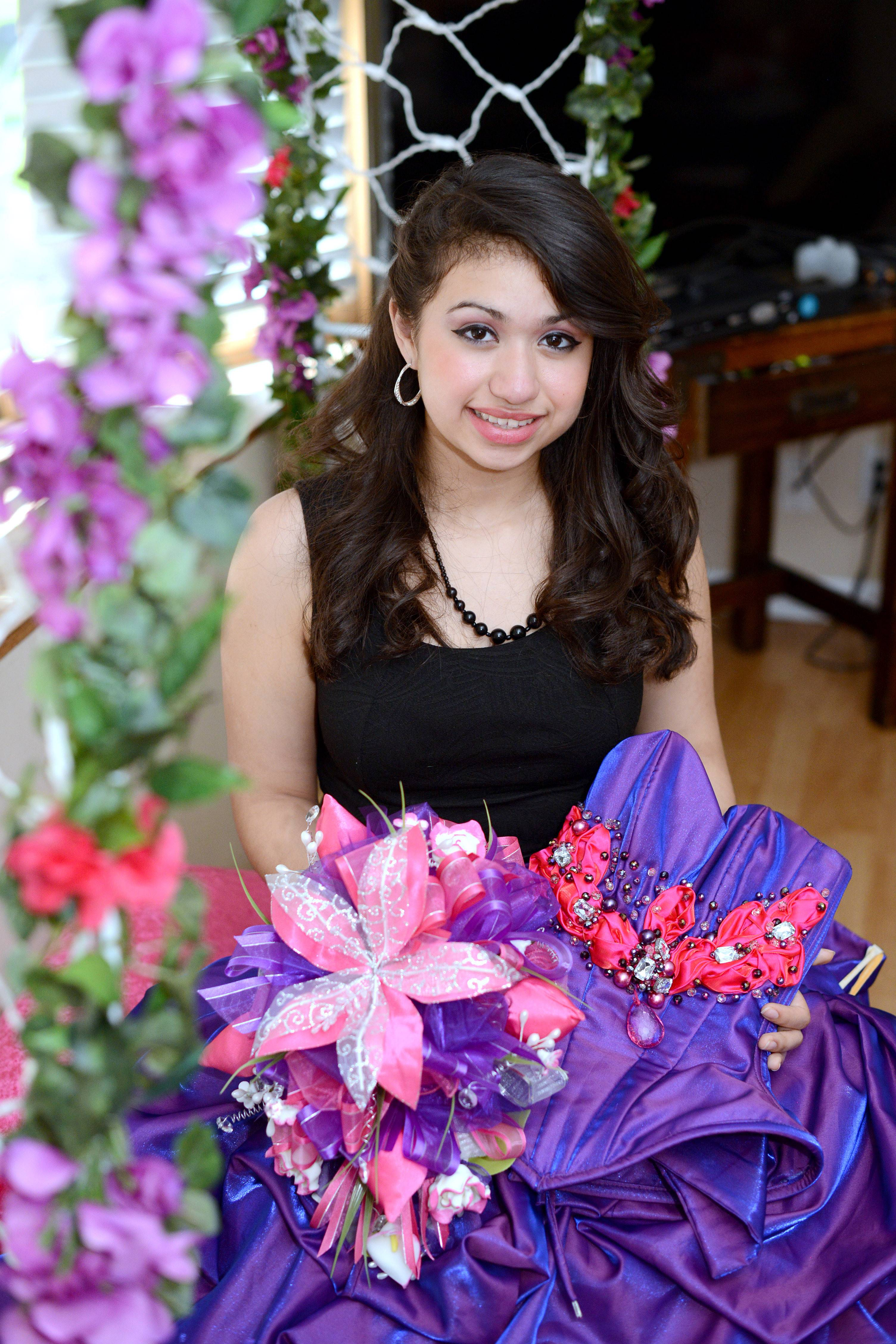 Bianca Huerta, 15, in the quinceañera dress her mother, Brandy, won for her through a Facebook contest.