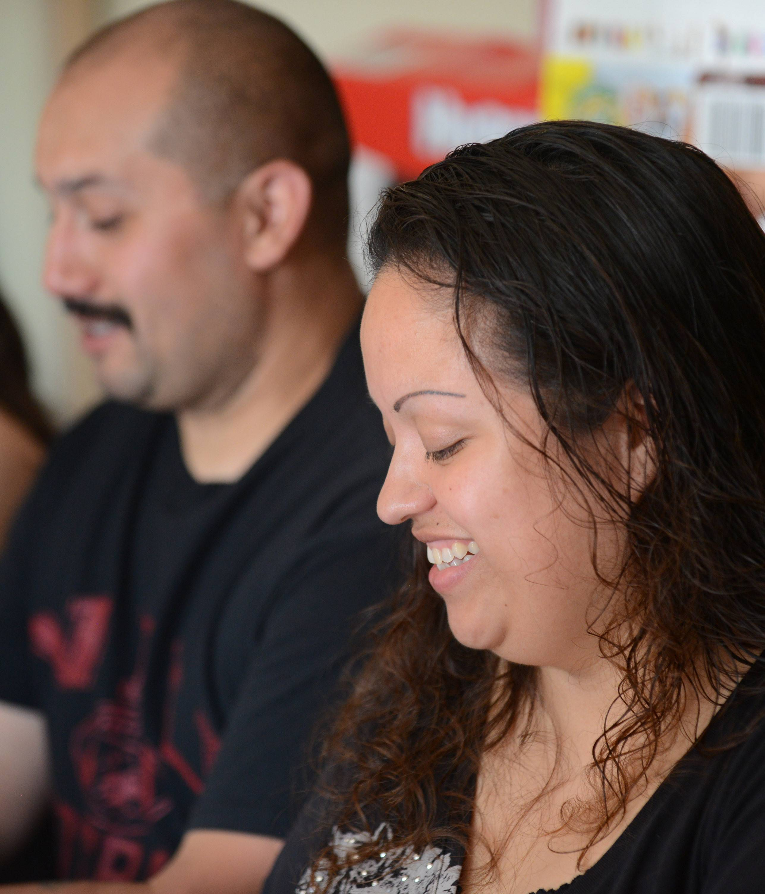 Seated next to her husband, Jose, Brandy Huerta of Carpentersville talks about how she entered several contests and raffles so her oldest daughter, Bianca, 15, could have a chance for a memorable quinceañera.