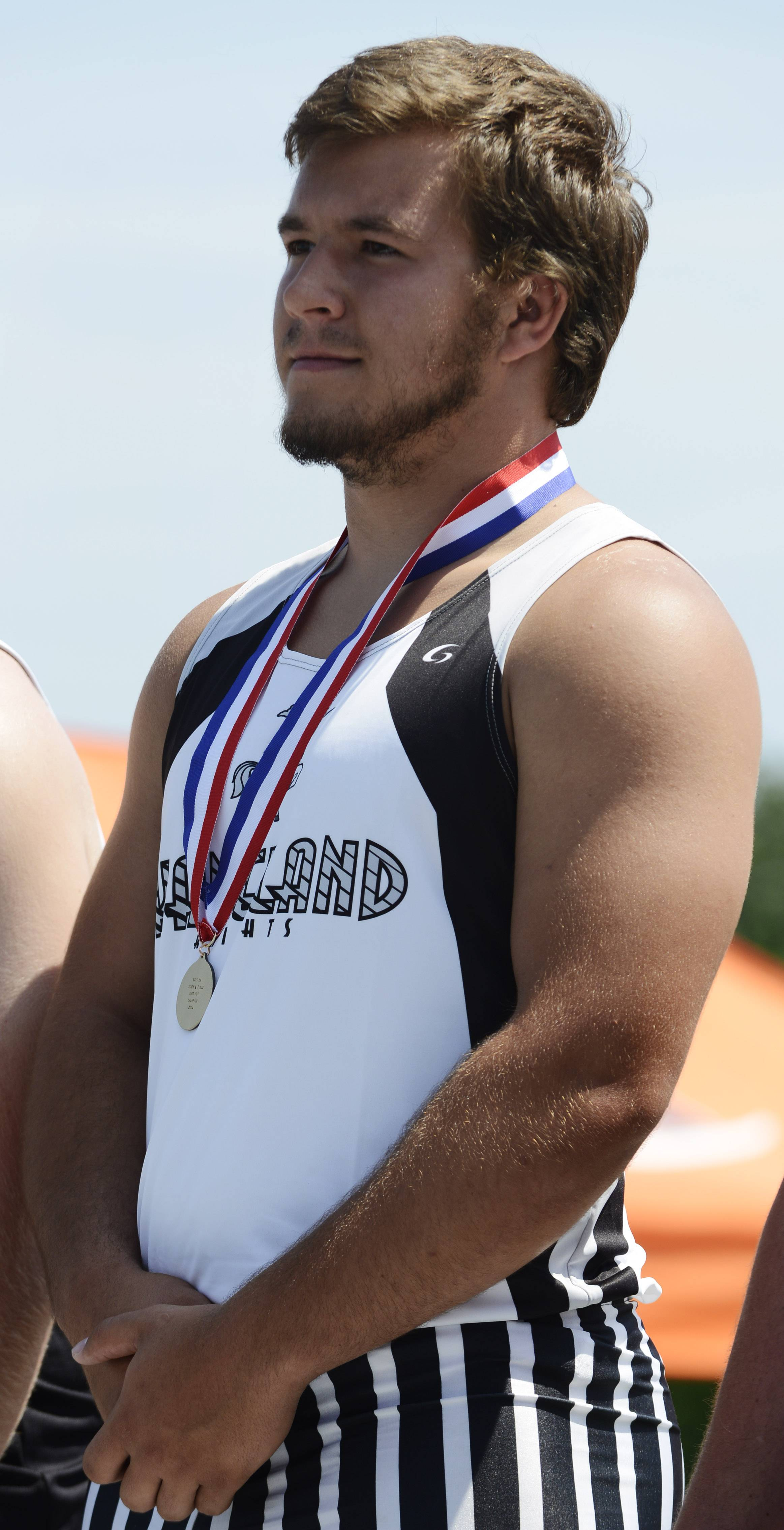 Joe Lewnard/jlewnard@dailyherald.comKaneland's Nate Dyer won the shot put during the boys class 2A state track and field finals in Charleston Saturday.