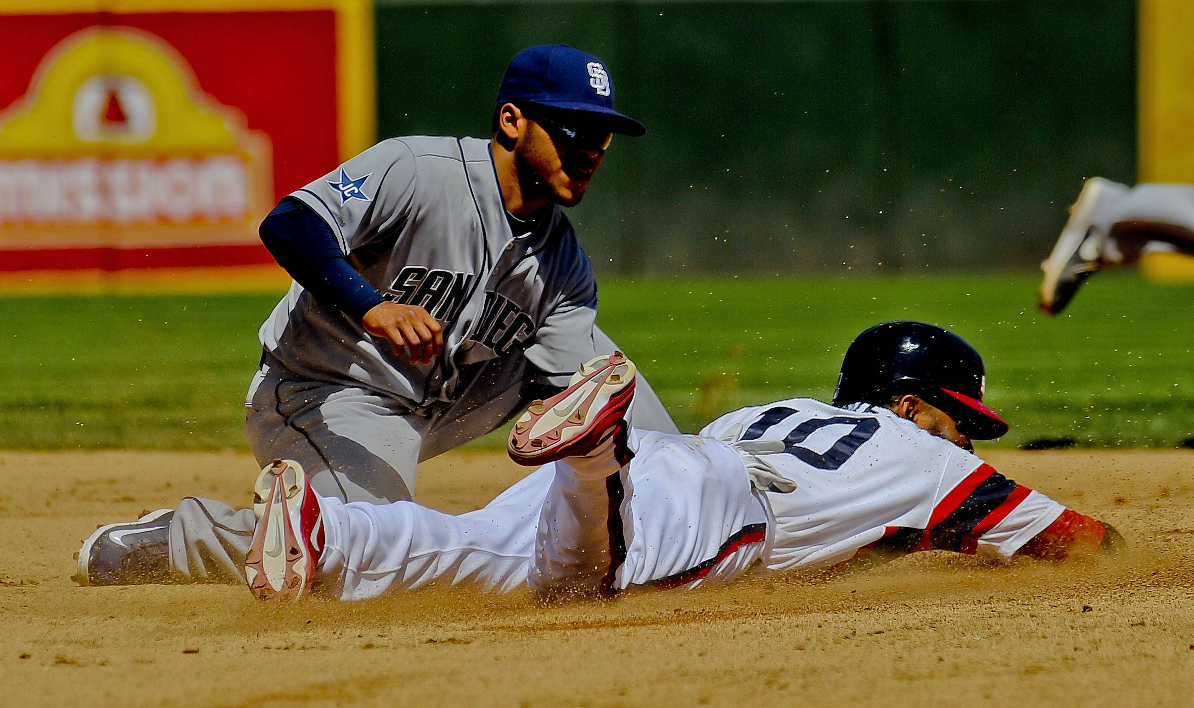 Alexei Ramirez steals second base against the Padres' Alexi Amirista during the fourth inning of Saturday's game at U.S. Cellular Field.