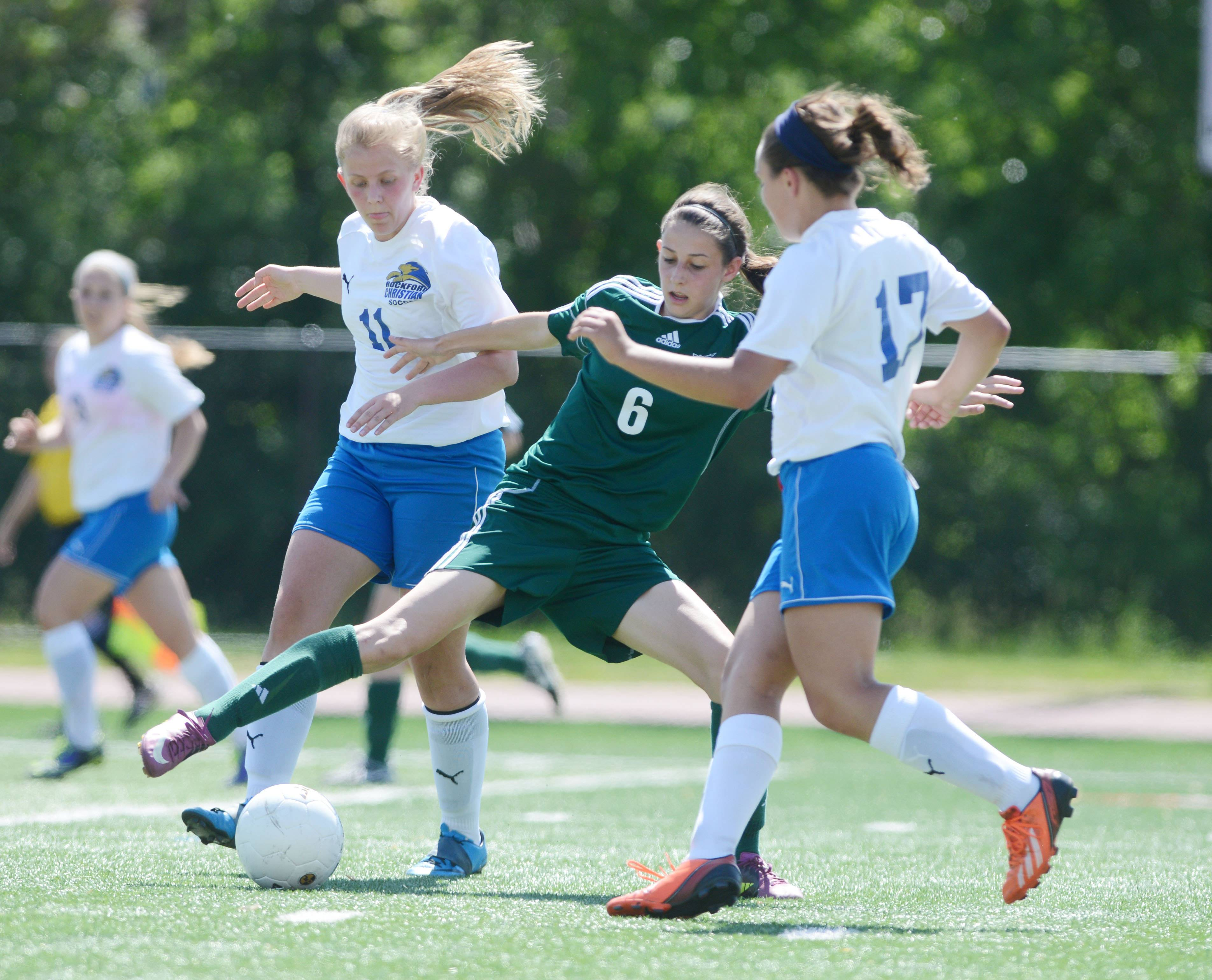 Chelsea Gnan of St. Edward moves the ball between two Rockford Christian defenders during the Class 1A state girls soccer third place game in Naperville Saturday.