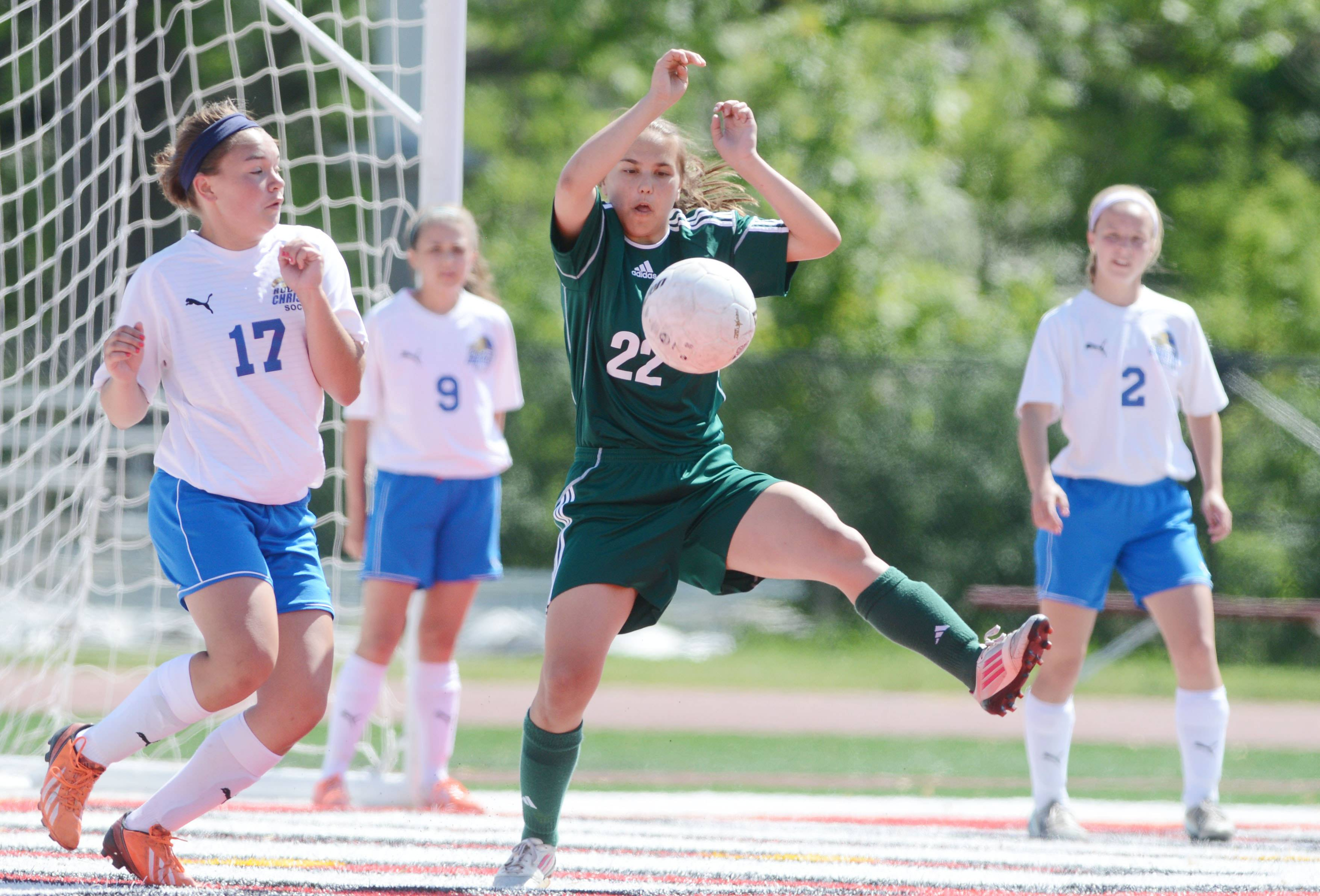 Maddie Spagnola of St. Edward controls the ball during the Class 1A state girls soccer third place game Saturday in Naperville.