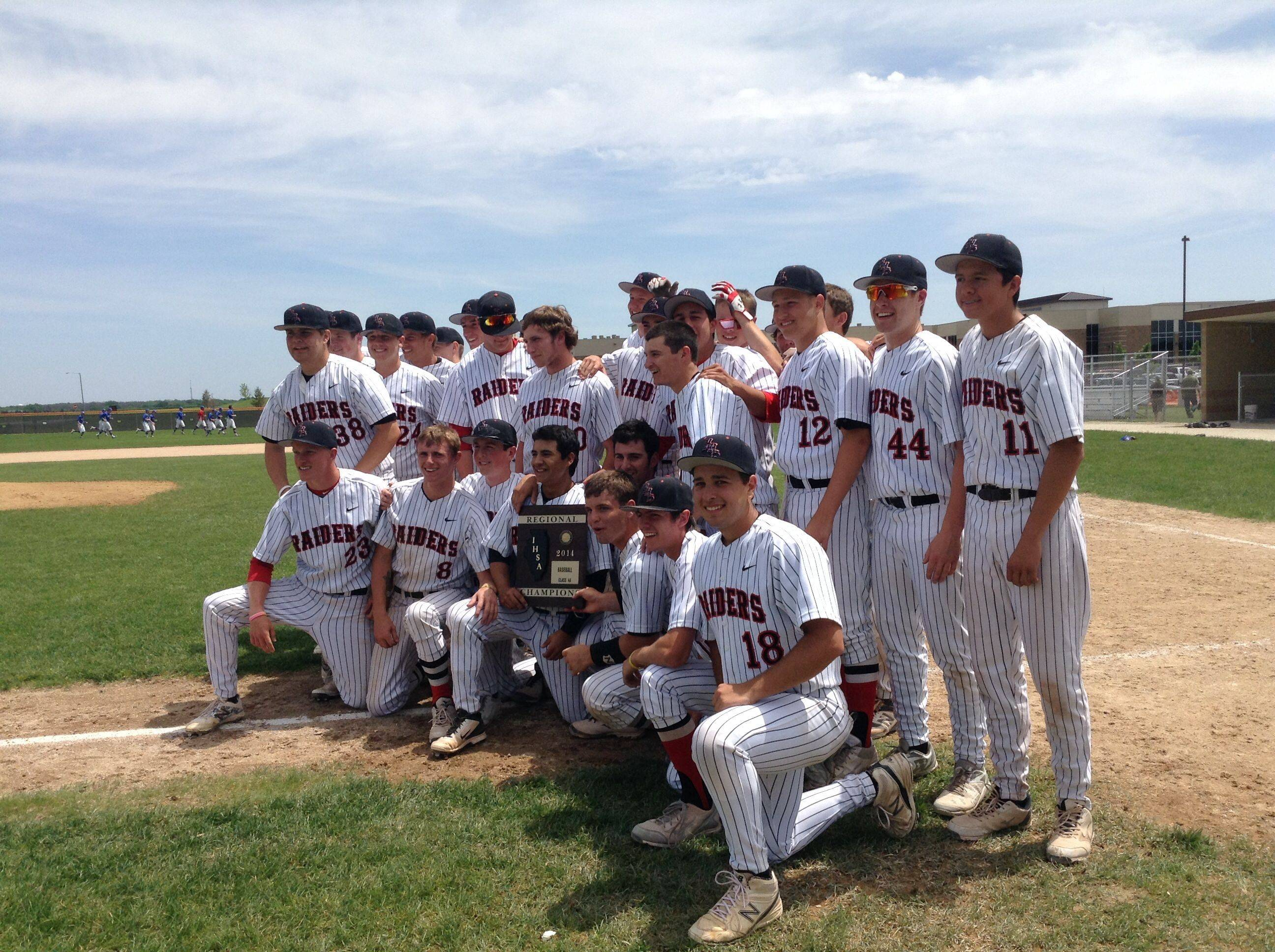 The Huntley baseball team displays the regional championship plaque it won at DeKalb on Saturday.