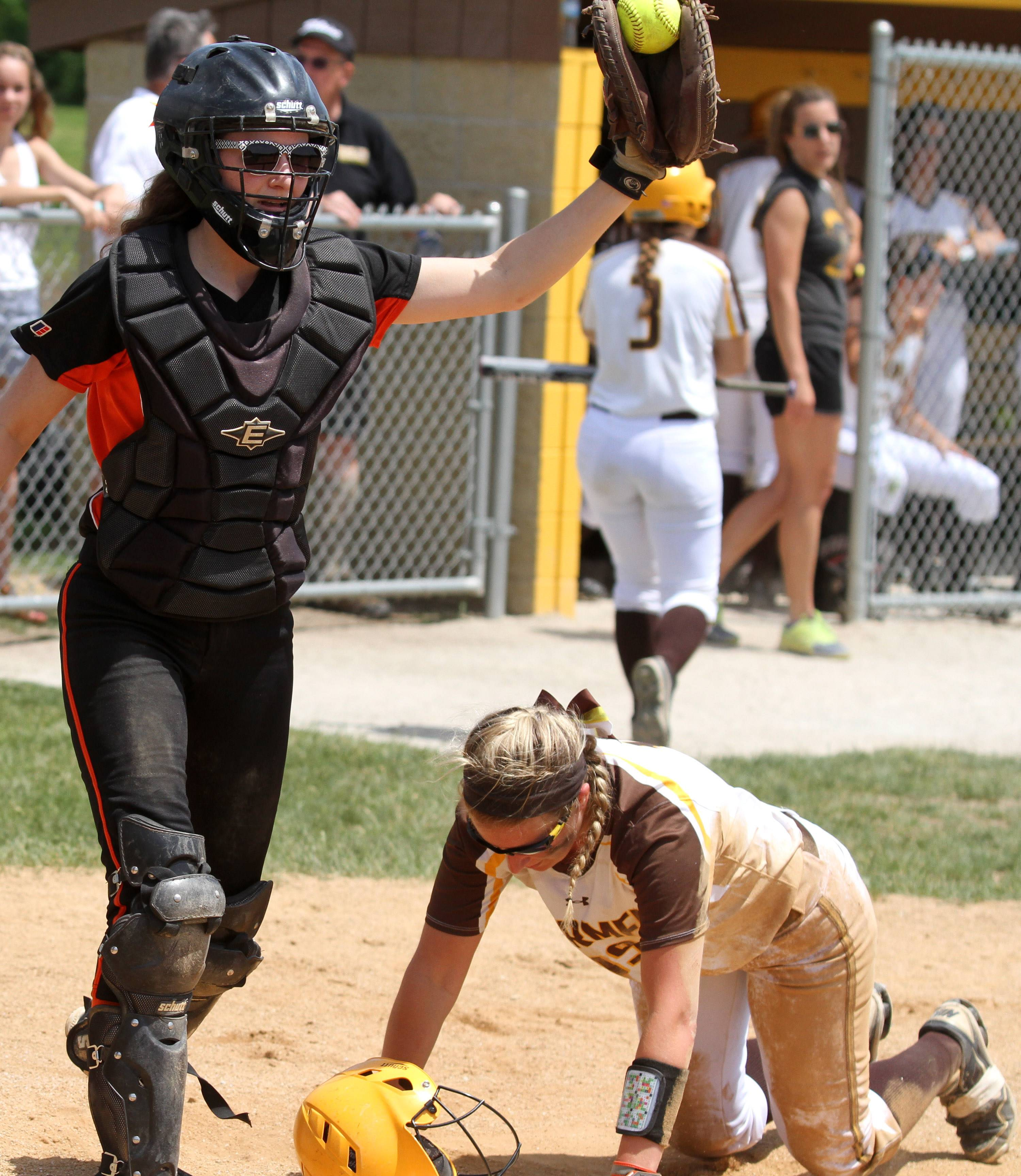 Libertyville catcher Andi Katz shows she has the ball after tagging out Carmel's Amy Abel at home plate in Class 4A regional final action Saturday in Mundelein.