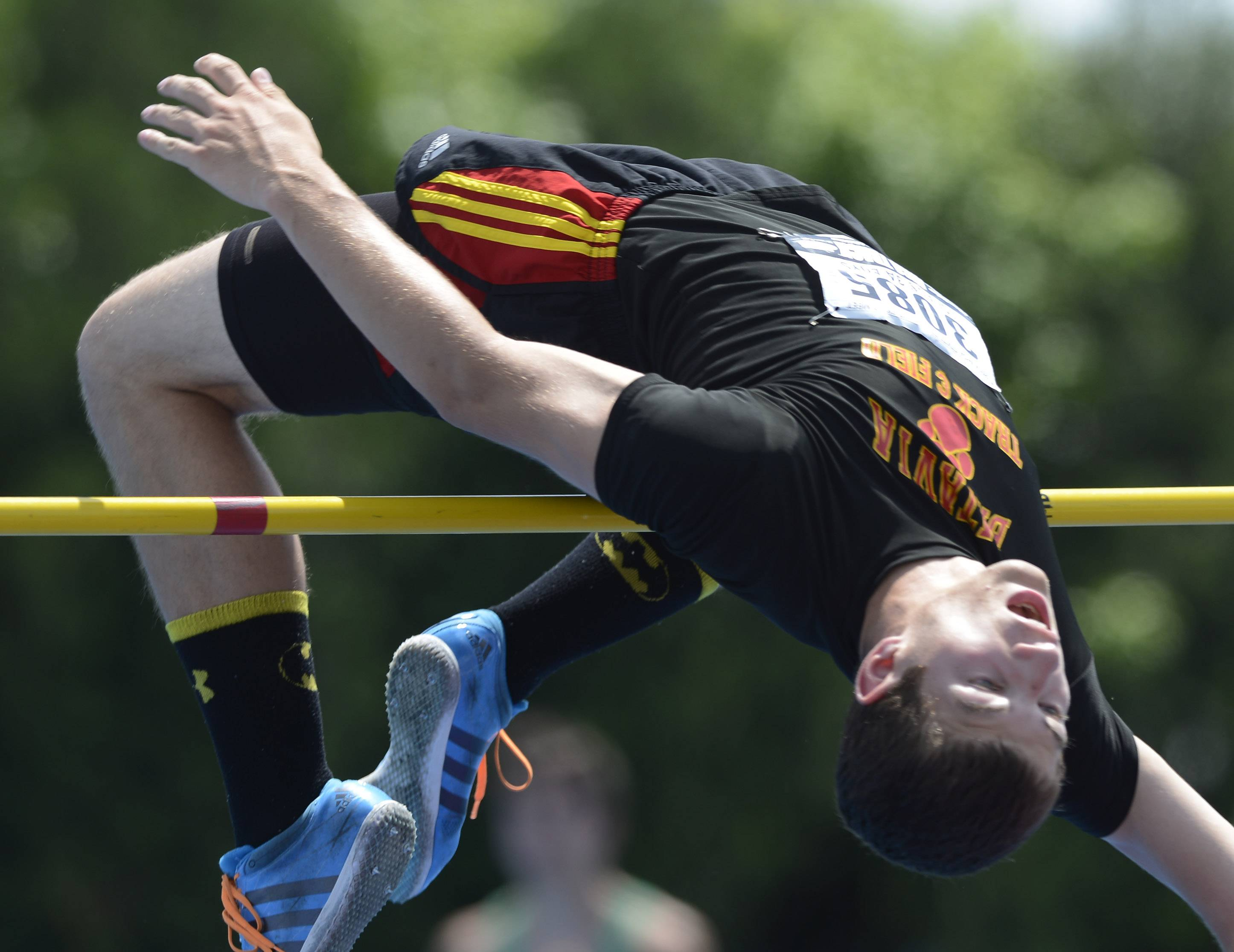 Batavia's Mark Rudelich clears the bar in the high jump during the boys class 3A state track and field finals in Charleston Saturday.