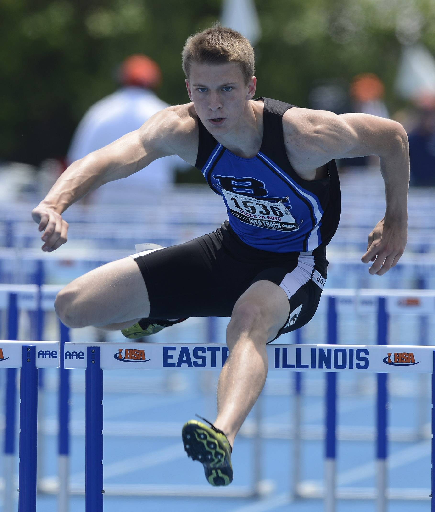 Burlington Central's Lucas Ege clears the final hurdle in the 110-meter high hurdles during the boys class 2A state track and field finals in Charleston Saturday.