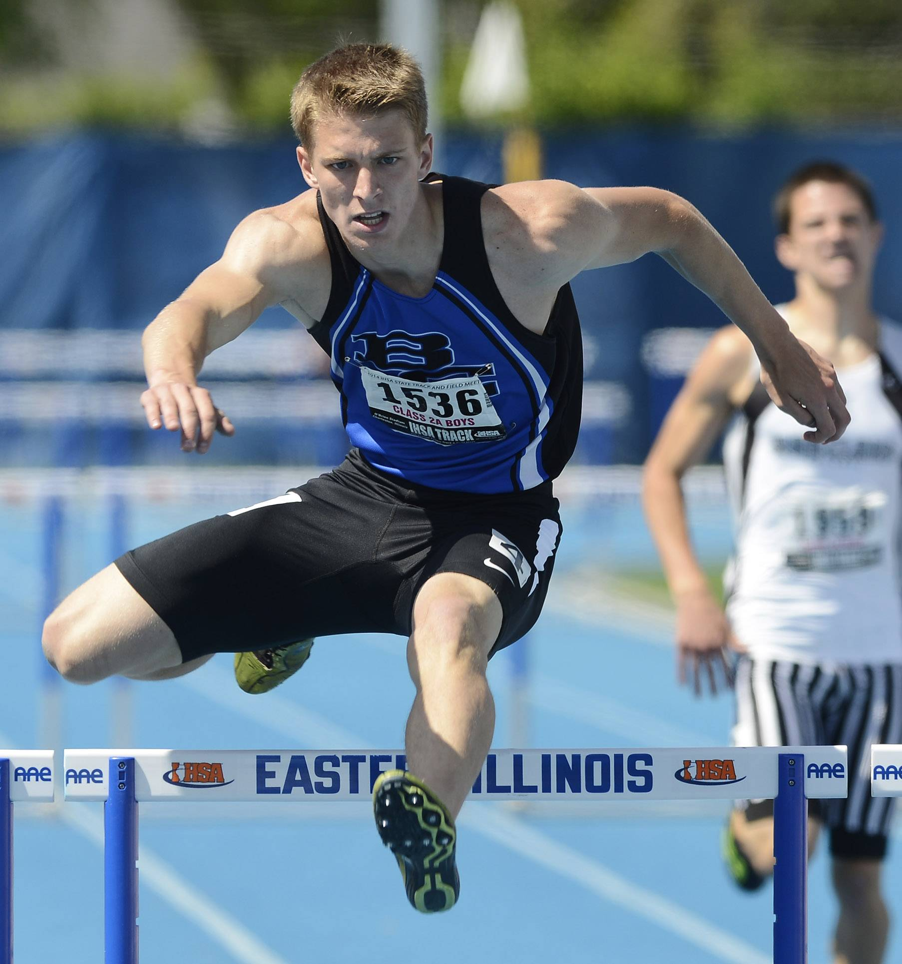 Burlington Central's Lucas Ege clears the last hurdle as he wins the 300-meter intermediate hurdles during the boys class 2A state track and field finals in Charleston Saturday.