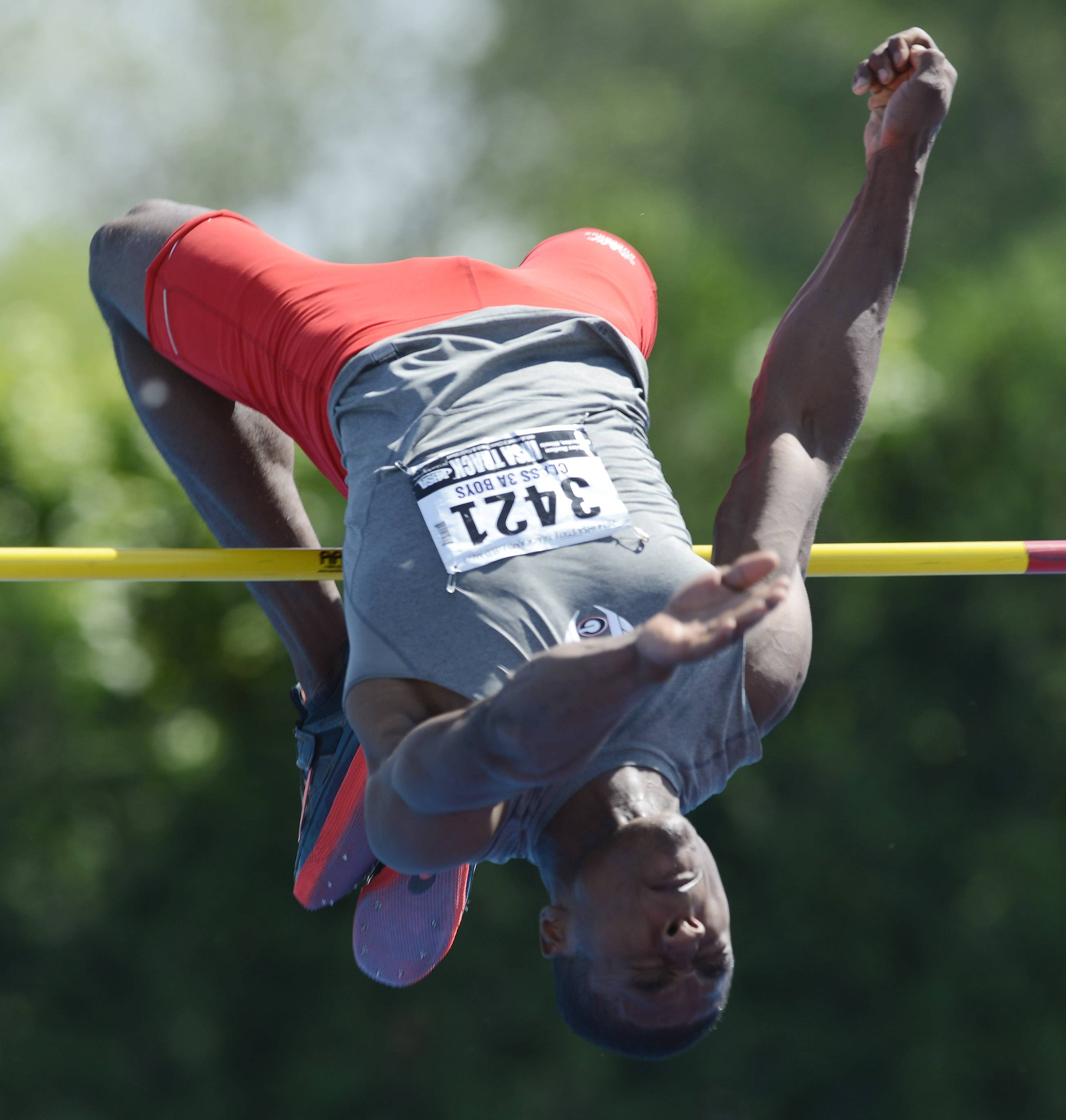 Grant's Jonathan Wells clears the high jump bar during the boys class 3A state track and field finals in Charleston Saturday.
