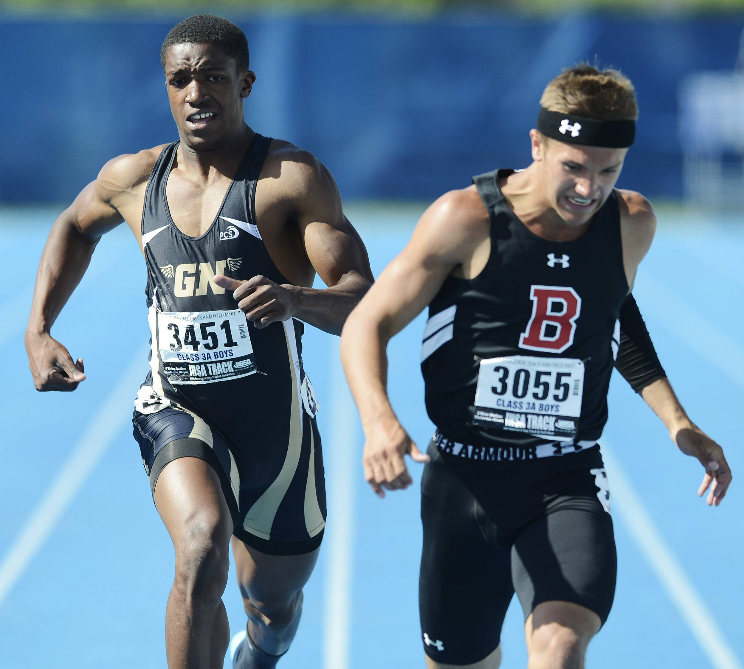 Barrington's Scotty Miller, right, and Grayslake North's Titus Booker cross the finish line in the 200-meter dash during the boys class 3A state track and field finals in Charleston Saturday.