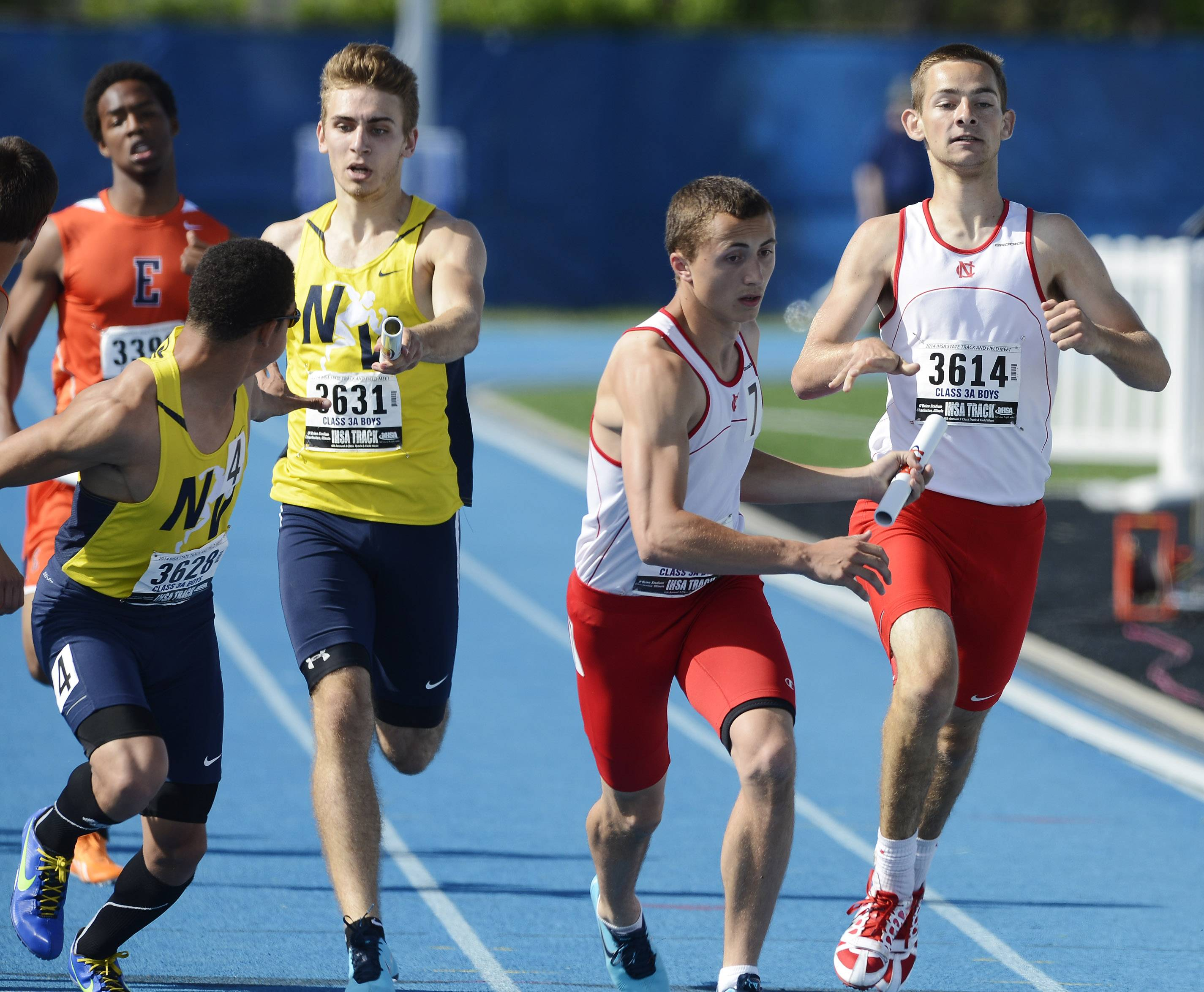Neuqua Valley's Ty Moss, left, takes the baton from teammate Nick Rafacz, while Naperville Central's Sam Bransby takes the baton from Michael Jopes in the 4x400-meter relay during the boys class 3A state track and field finals in Charleston Saturday.