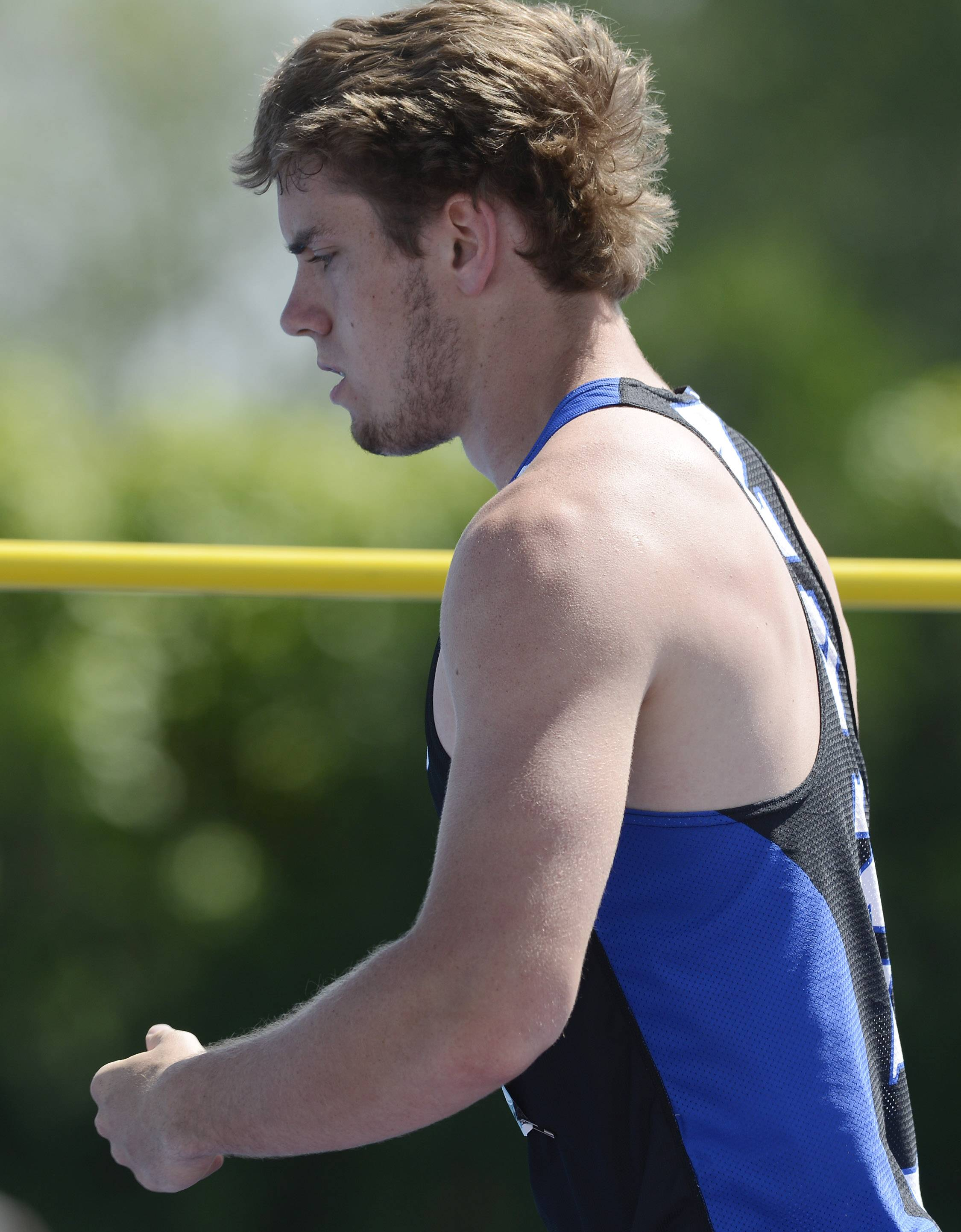 St. Charles North's Erik Miller pumps his fist as he becomes one of two competitors left in the high jump during the boys class 3A state track and field finals in Charleston Saturday. The event was won by Grant's Jonathan Wells.