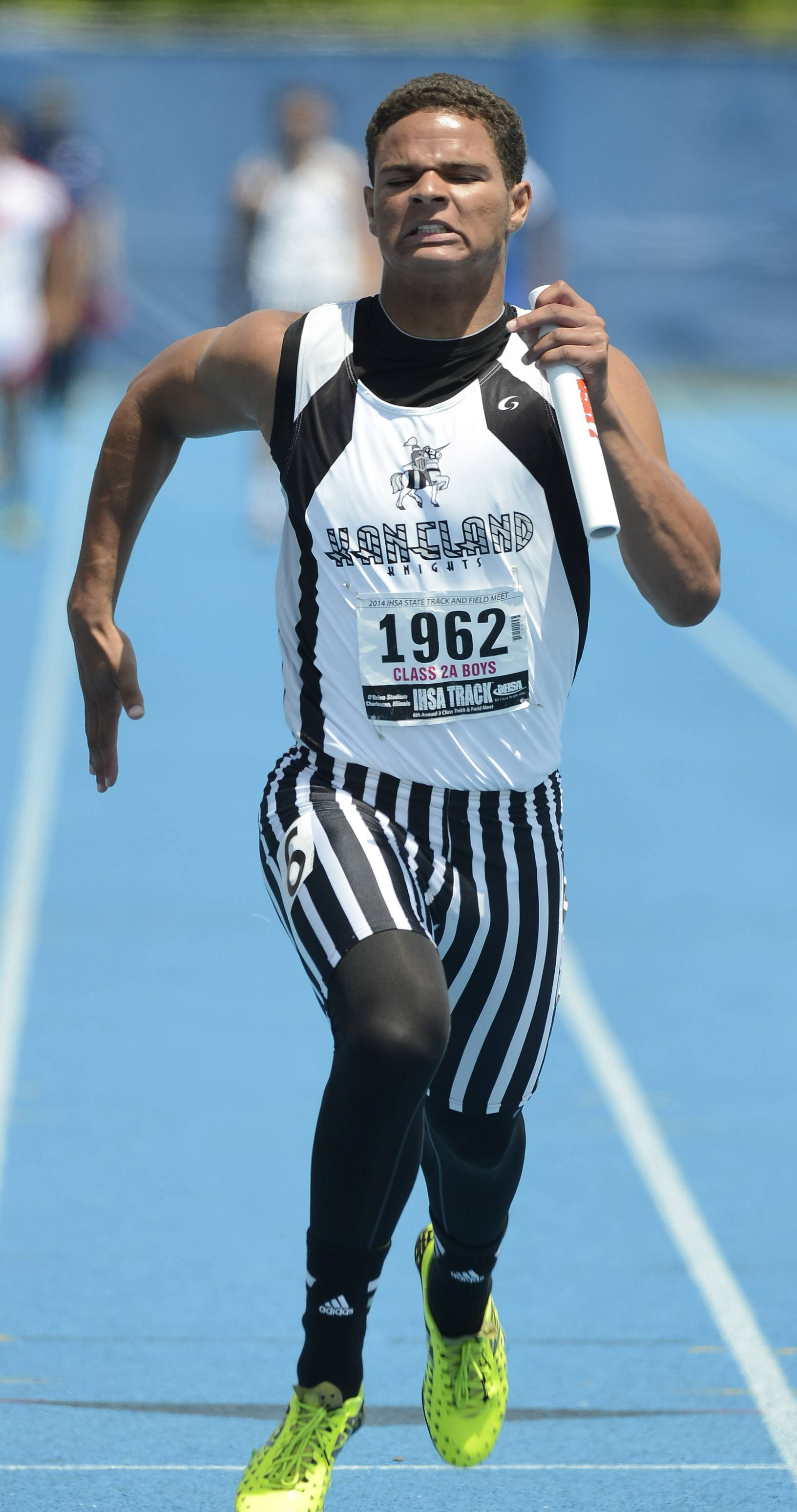 Kaneland's Issac Swithers crosses the finish line for his team in the 4x100-meter relay during the boys class 2A state track and field finals in Charleston Saturday.