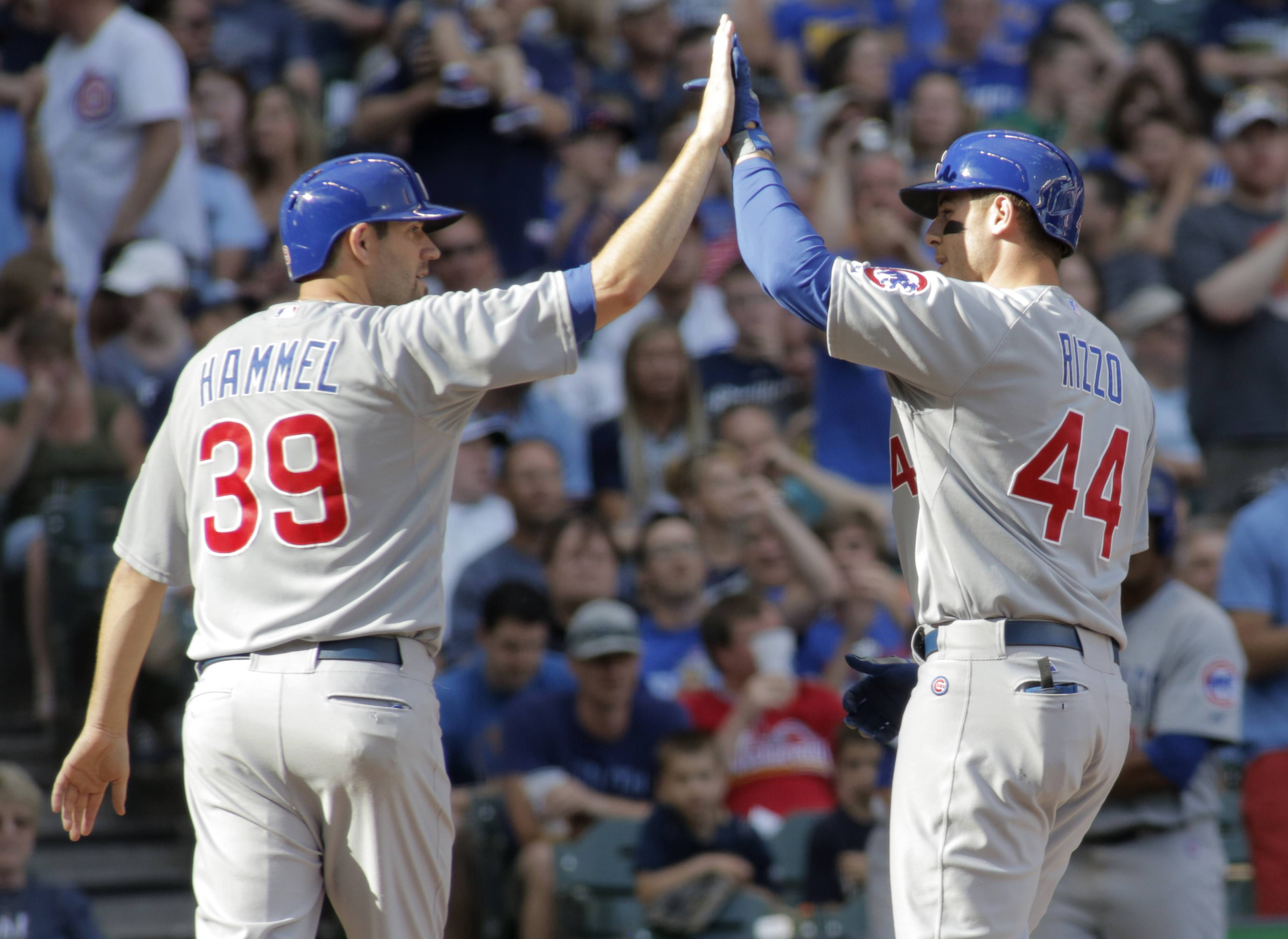 The Cubs' Jason Hammel, left, congratulates Anthony Rizzo after his a two-run home run against the Brewers in the sixth inning Saturday in Milwaukee.