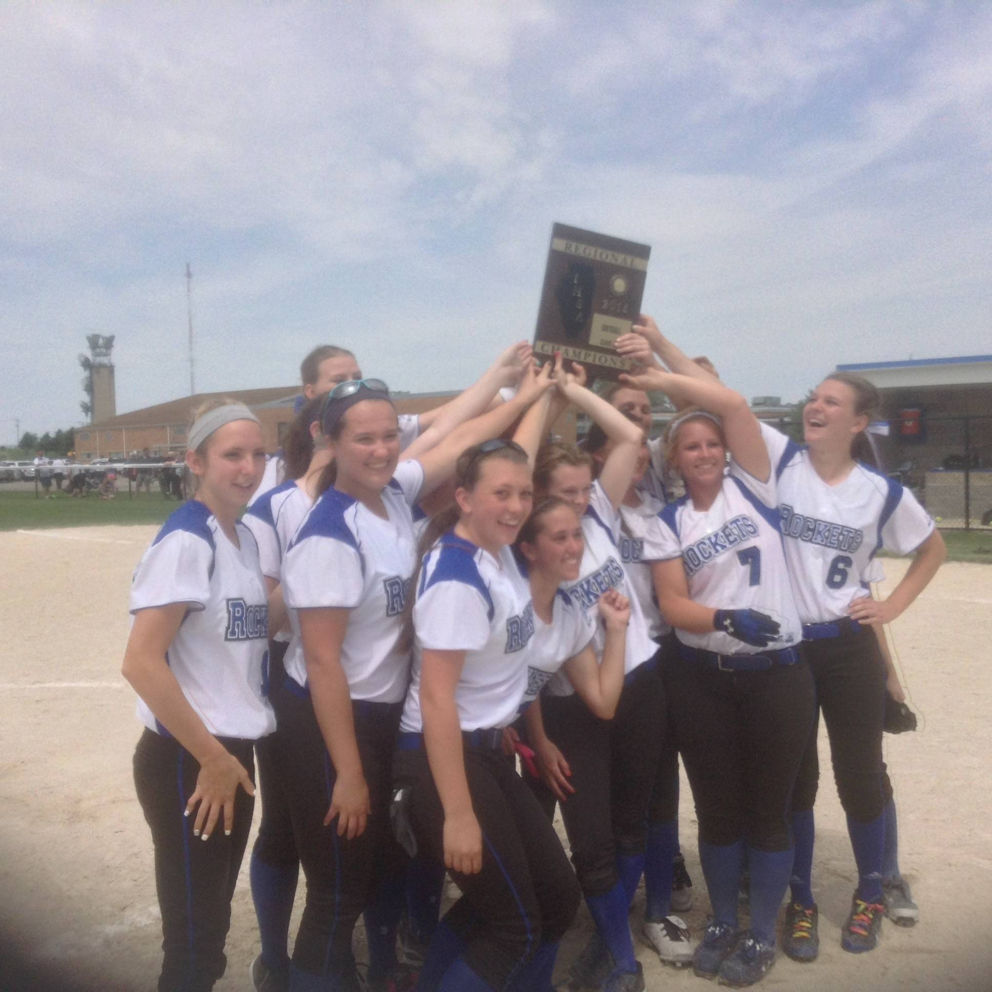 The Burlington Central softball team celebrates its Class 3A regional championship win over Kaneland Saturday at Burlington.
