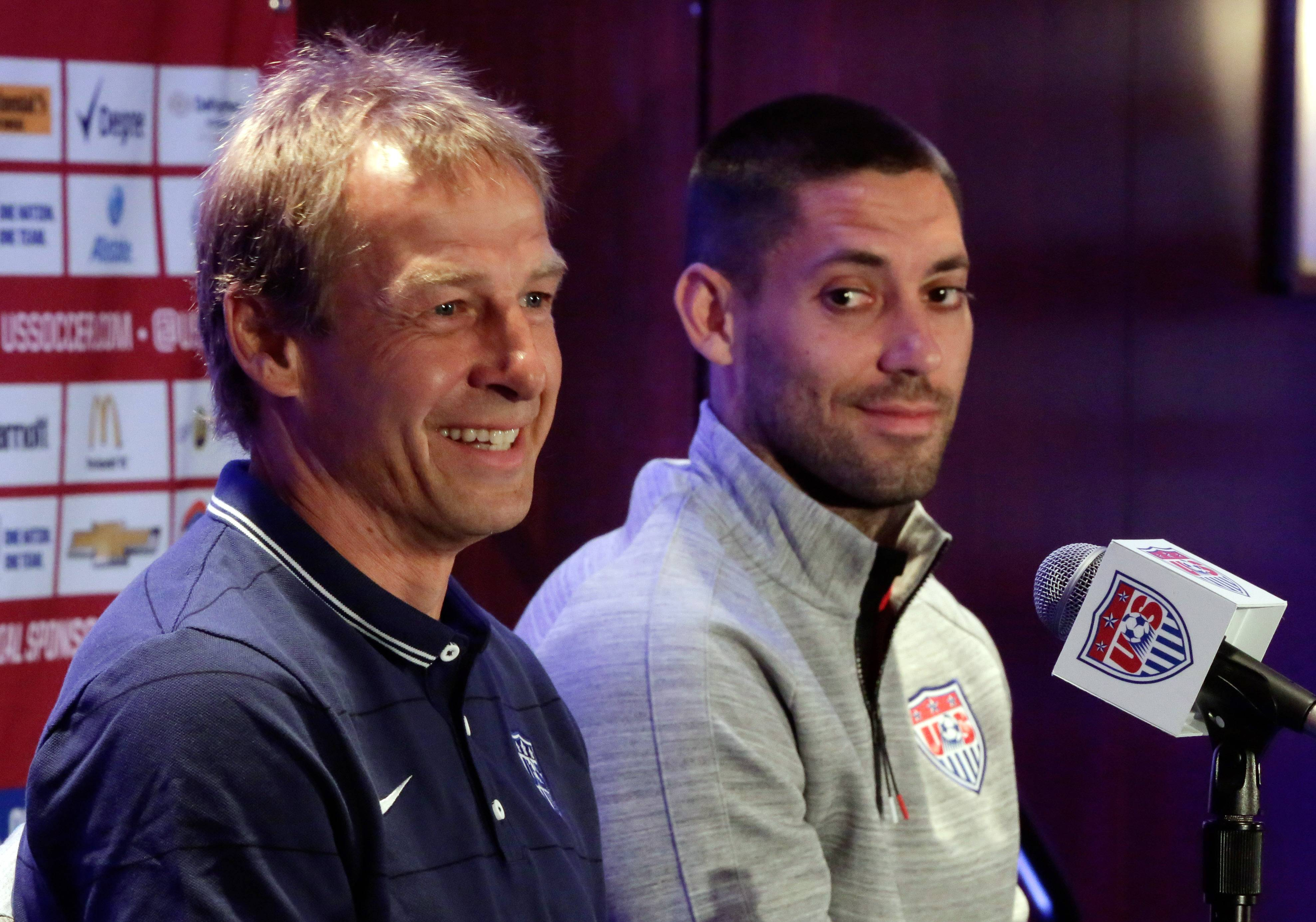 U.S. men's soccer coach Jurgen Klinsmann, left, with World Cup team captain Clint Dempsey, says it doesn't matter what formation he employs. What matters is how the team attacks and defends at the time.