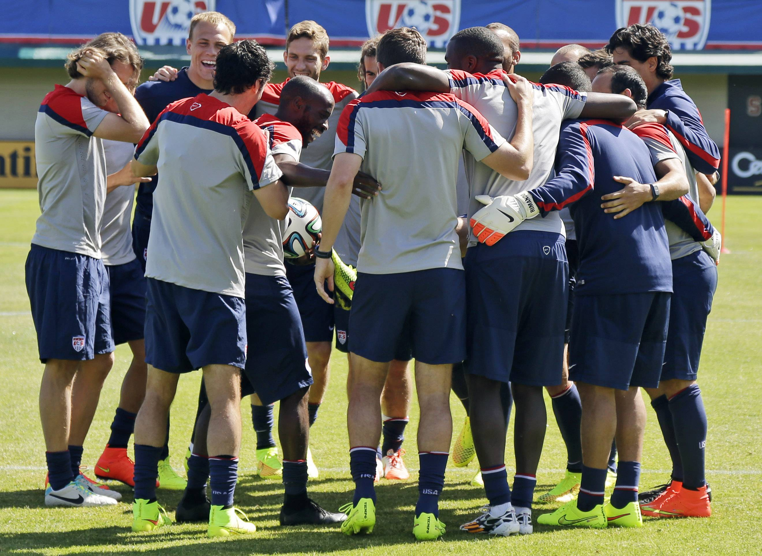 U.S. men's soccer team members embrace during training in preparation for the World Cup. The team will play Turkey in a friendly Sunday in New Jersey before heading to Florida to practice in steamier conditions and the World Cup in Brazil.