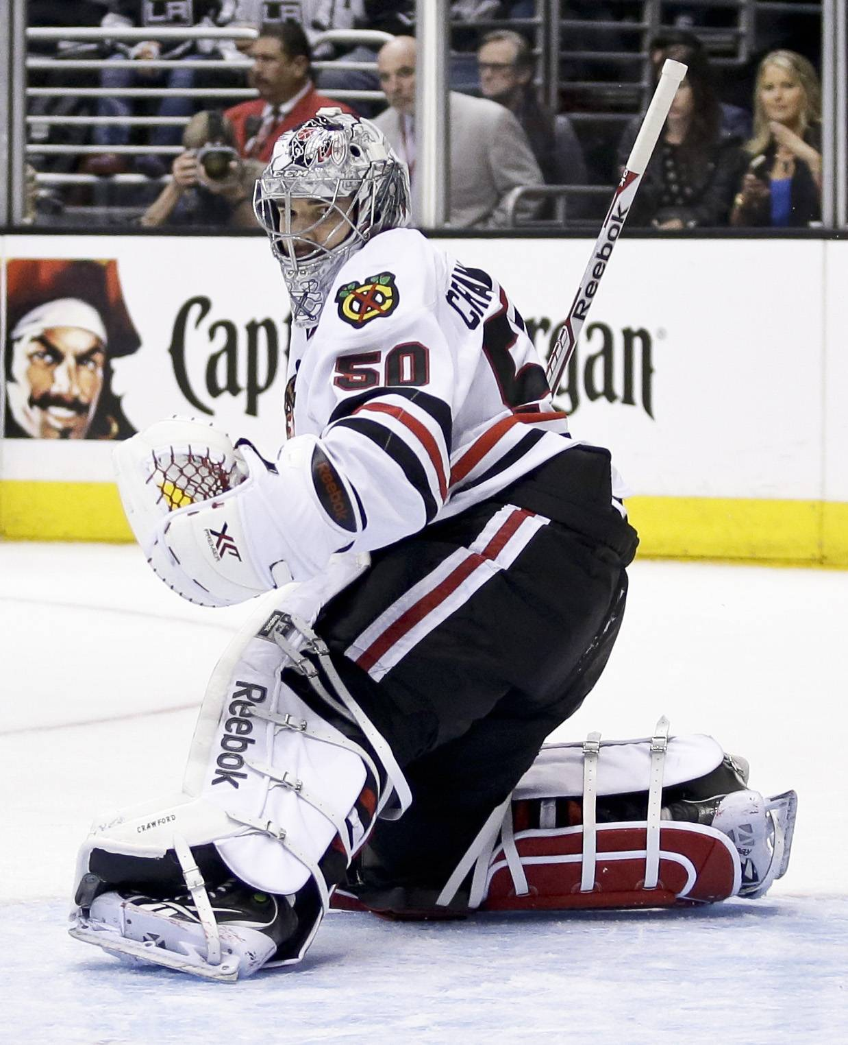 Blackhawks goalie Corey Crawford blocks a shot against the Kings during Game 6 of the Western Conference finals Friday night.