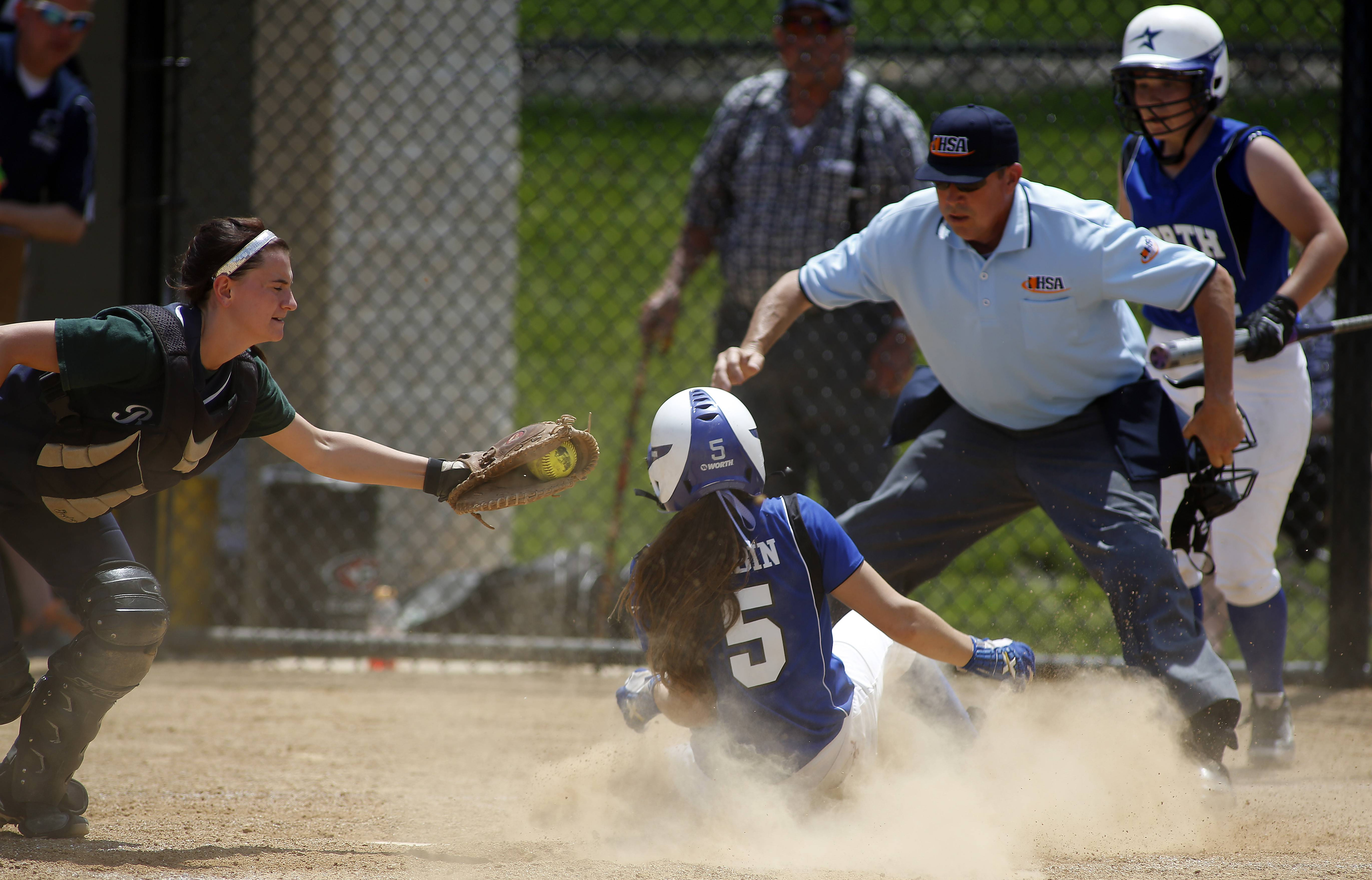 Bartlett's Dana Paul can't get a tag on St. Charles North's Sabrina Rabin late in the championship game of Class 4A Addison Trail regional Saturday.
