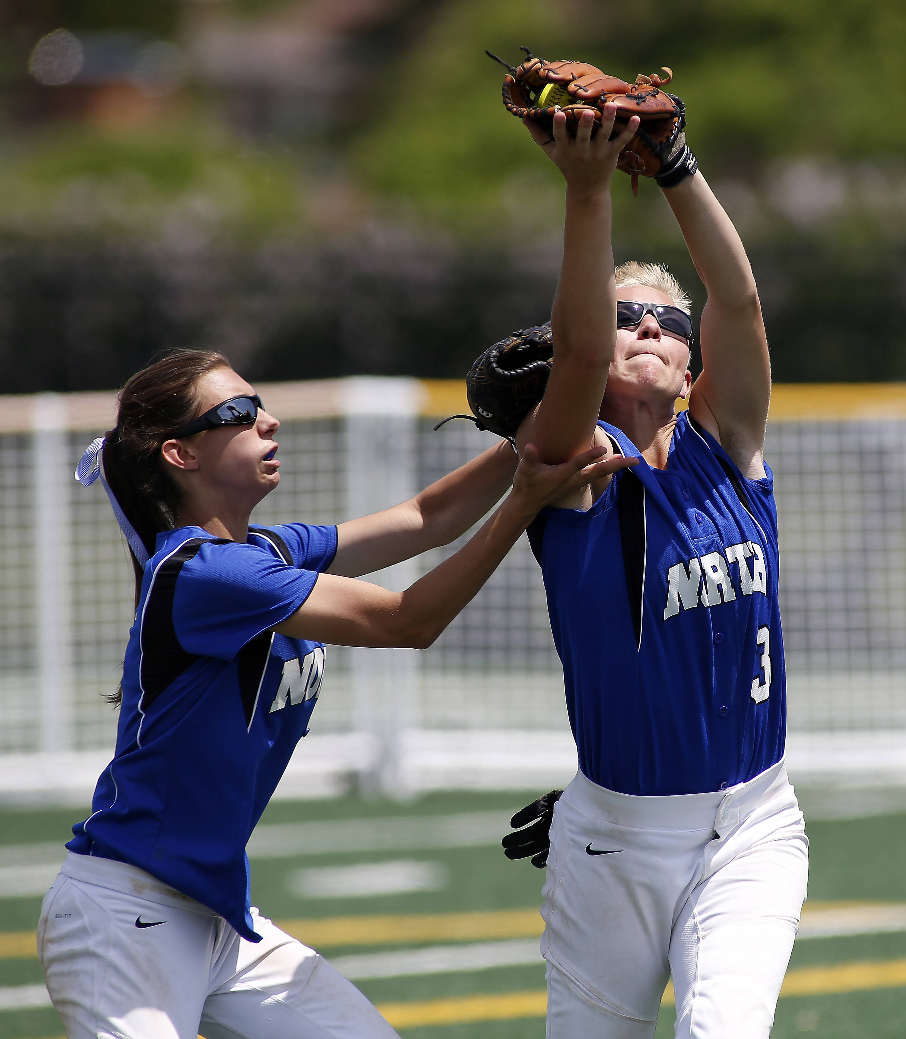 St. Charles North's Jordyn Wolfe, left, and Andrea Beal almost collide while reeling in a long shot to left field against Bartlett in the championship game of Class 4A Addison Trail regional.