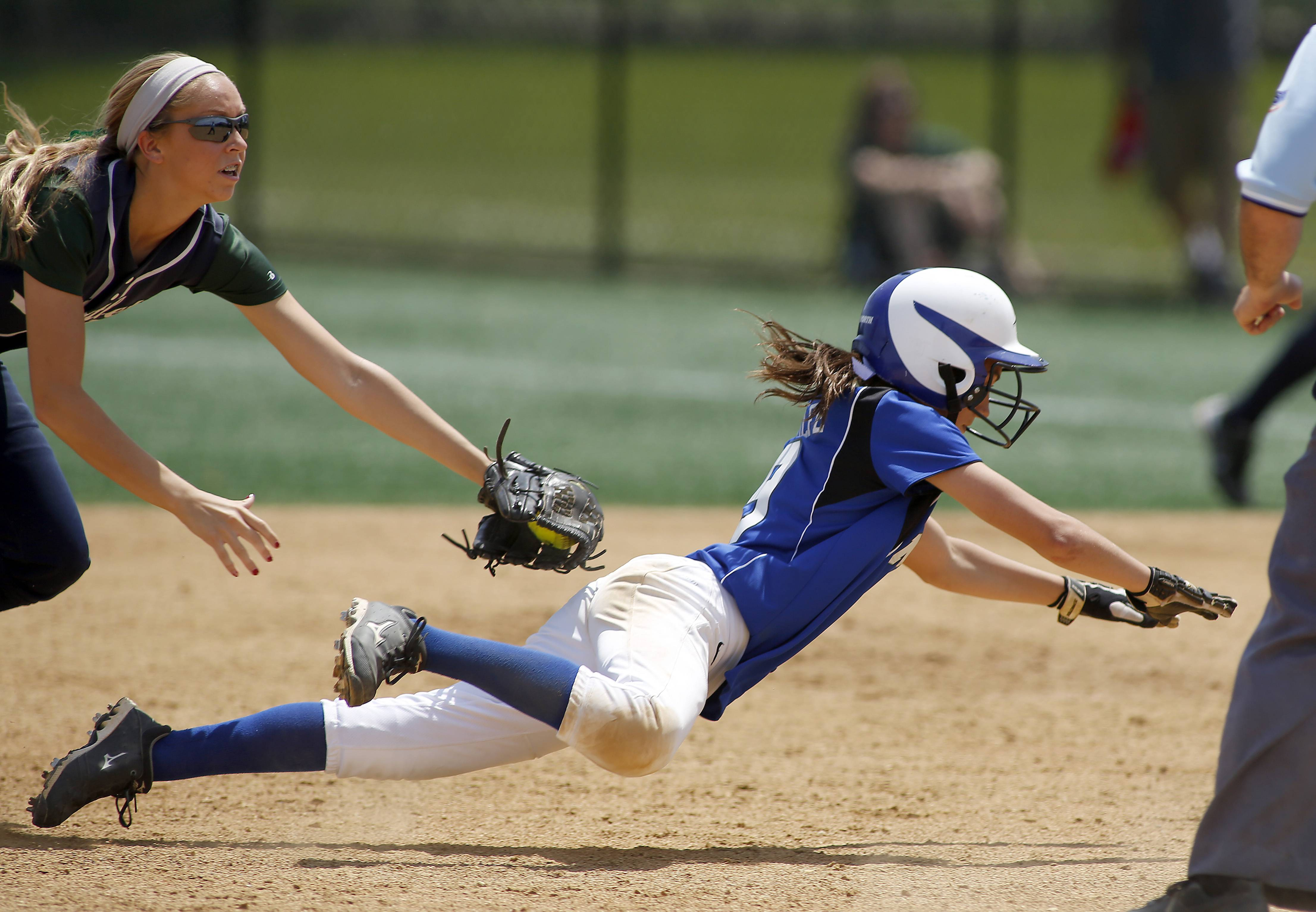 Bartlett's Alex Morales puts the tag on St. Charles North's Jordyn Wolfe during a rundown late in the championship game of Class 4A Addison Trail regional Saturday.
