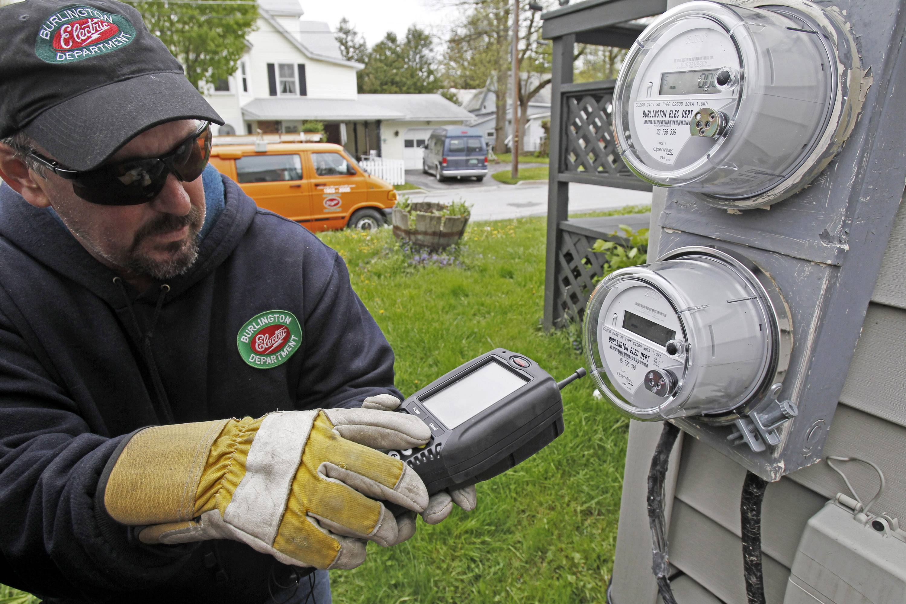 "Mark Delbeck of Burlington Electric checks the radio frequency of a newly-installed ""smart"" meter in Burlington, Vt. Electricity prices are expected to rise faster this year than they have since 2009, to a record average of 12.5 cents per kilowatt-hour, according to the Energy Department. And prices are highest in the summer, just when you need more power to run the air conditioner."