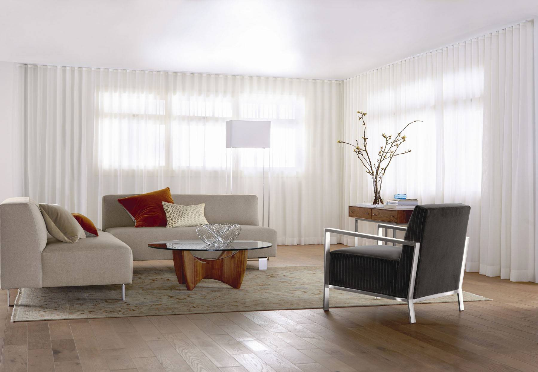 Courtesy of Room + Board Window treatments can make your small room look grand, even if the windows are not.