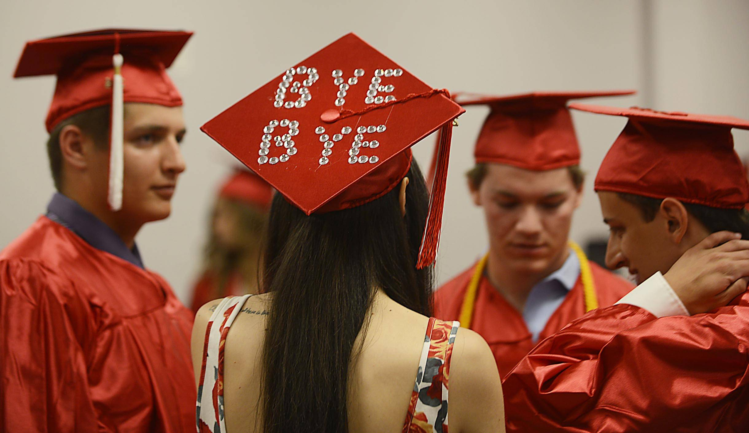 Graduate Erin Bartolone wears a message on her mortarboard at the Aurora Christian High School commencement ceremony Sunday in Aurora.