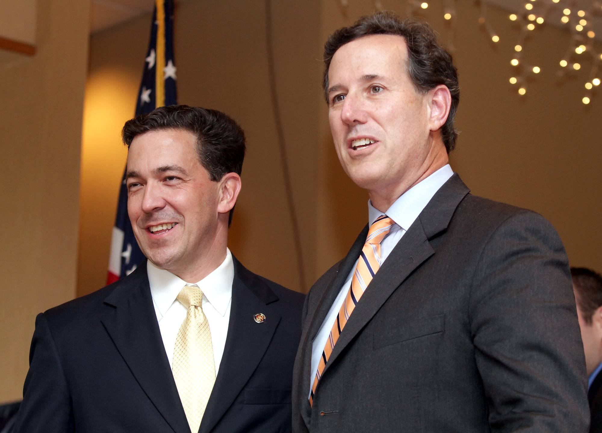 Former U.S. Sen. Rick Santorum, right, a Pennsylvania Republican, stands beside U.S. Sen. candidate Chris McDaniel during a rally on Saturday in Diamondhead, Miss.