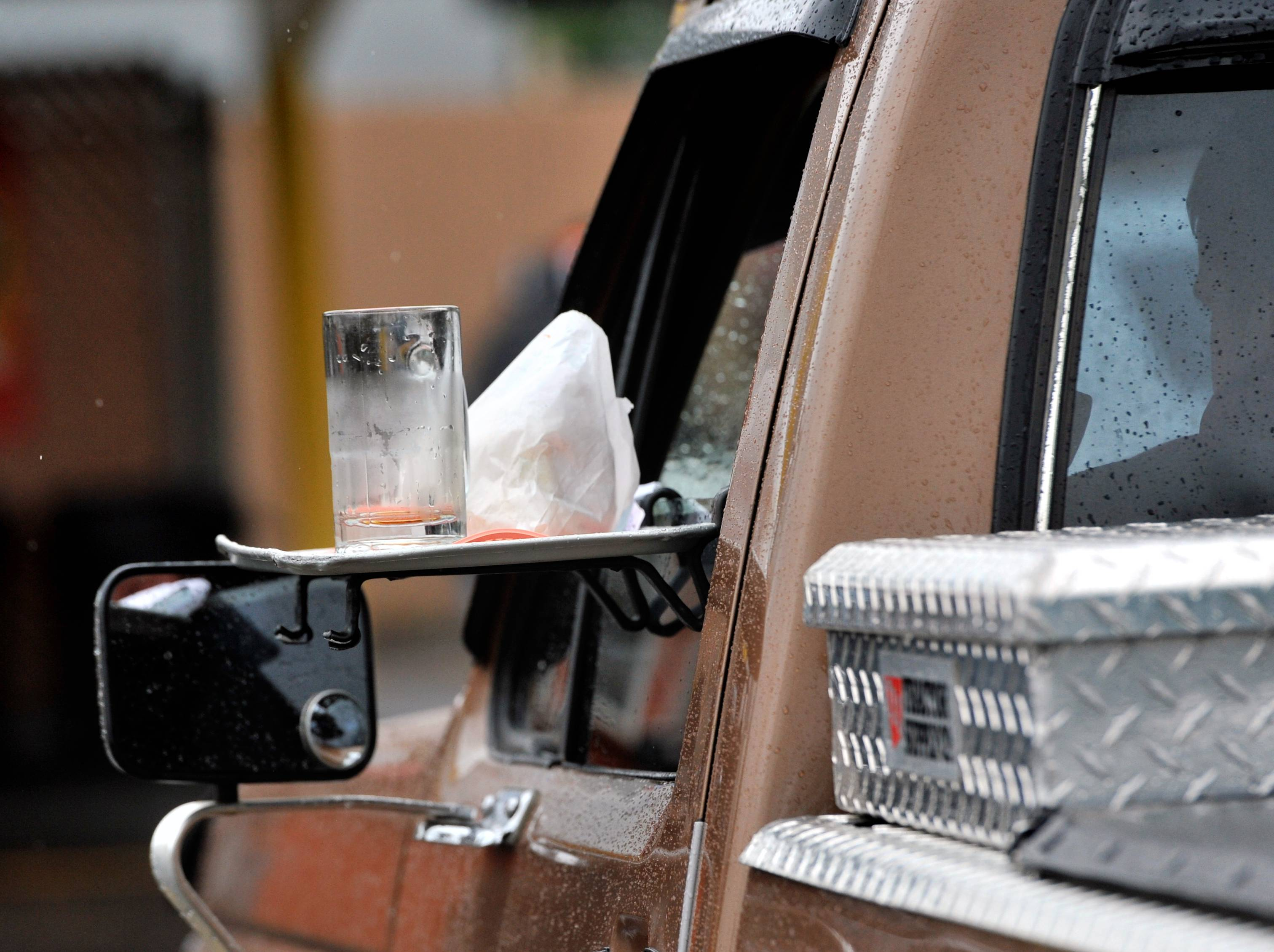 A tray of food sits on the window waiting for a car hop to pick it up earlier this month at Carlson's Drive-In in Michigan City, Ind.