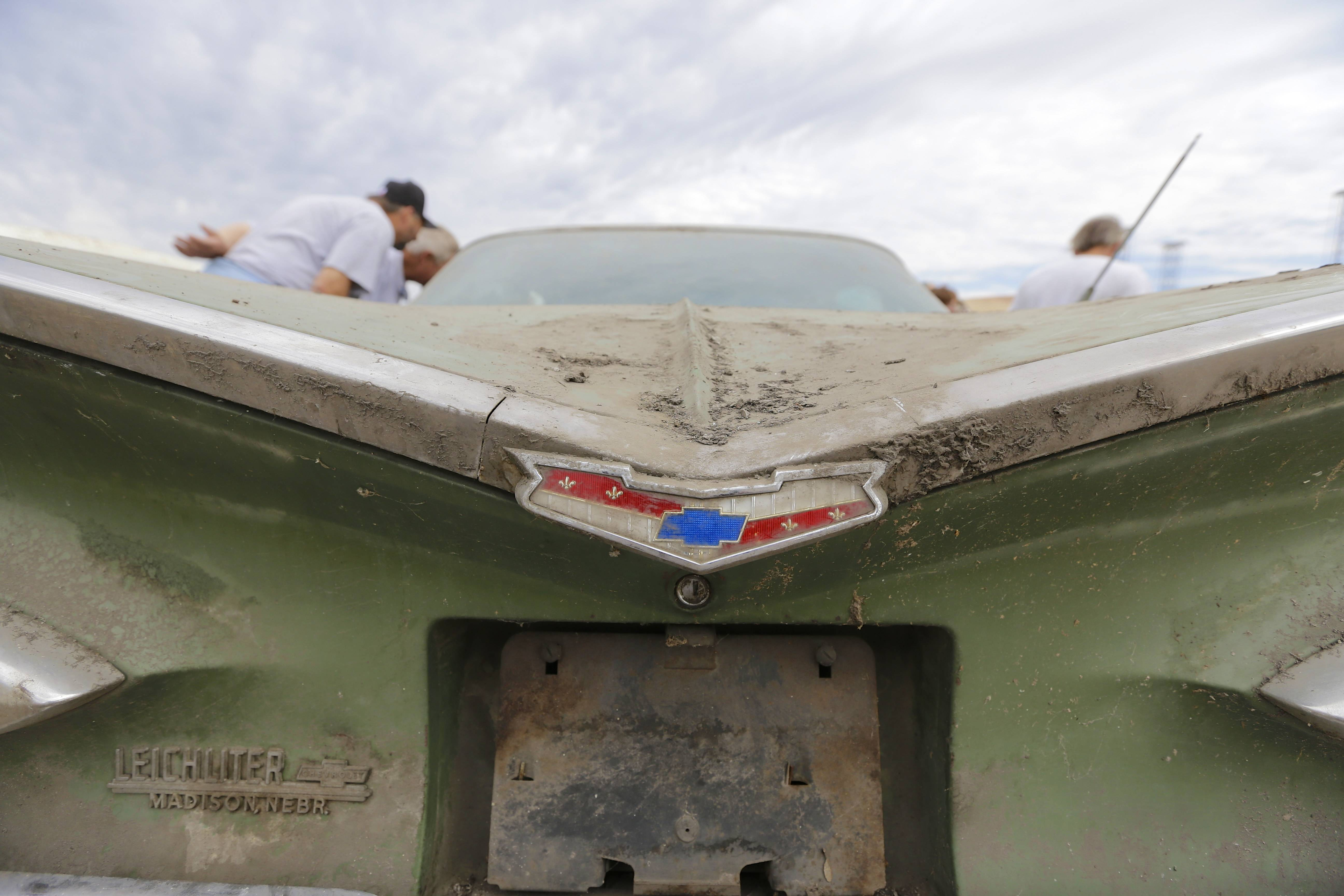 A Chevy Impala is looked at during a preview for an auction of vintage cars and trucks from the former Lambrecht Chevrolet dealership in Pierce, Nebraska.