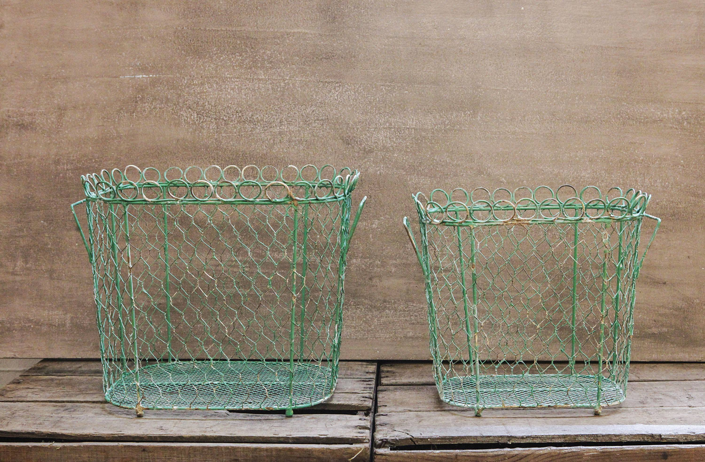 Turquoise wire baskets, like these from Farmhouse Wares, have a French garden vibe that's on trend this spring and summer.  Use them for storing everything from pet gear to laundry supplies to magazines and books.