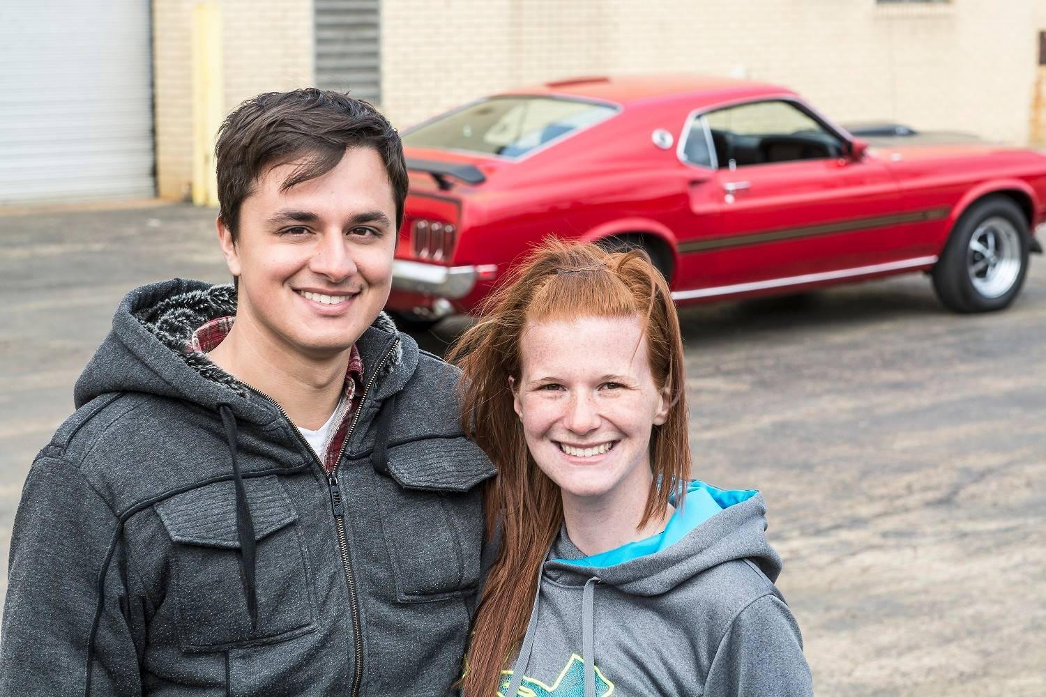 Monico Chavez of Vernon Hills and his girlfriend, Emily Grimm, enjoy cruising in his 1969 Mach 1.