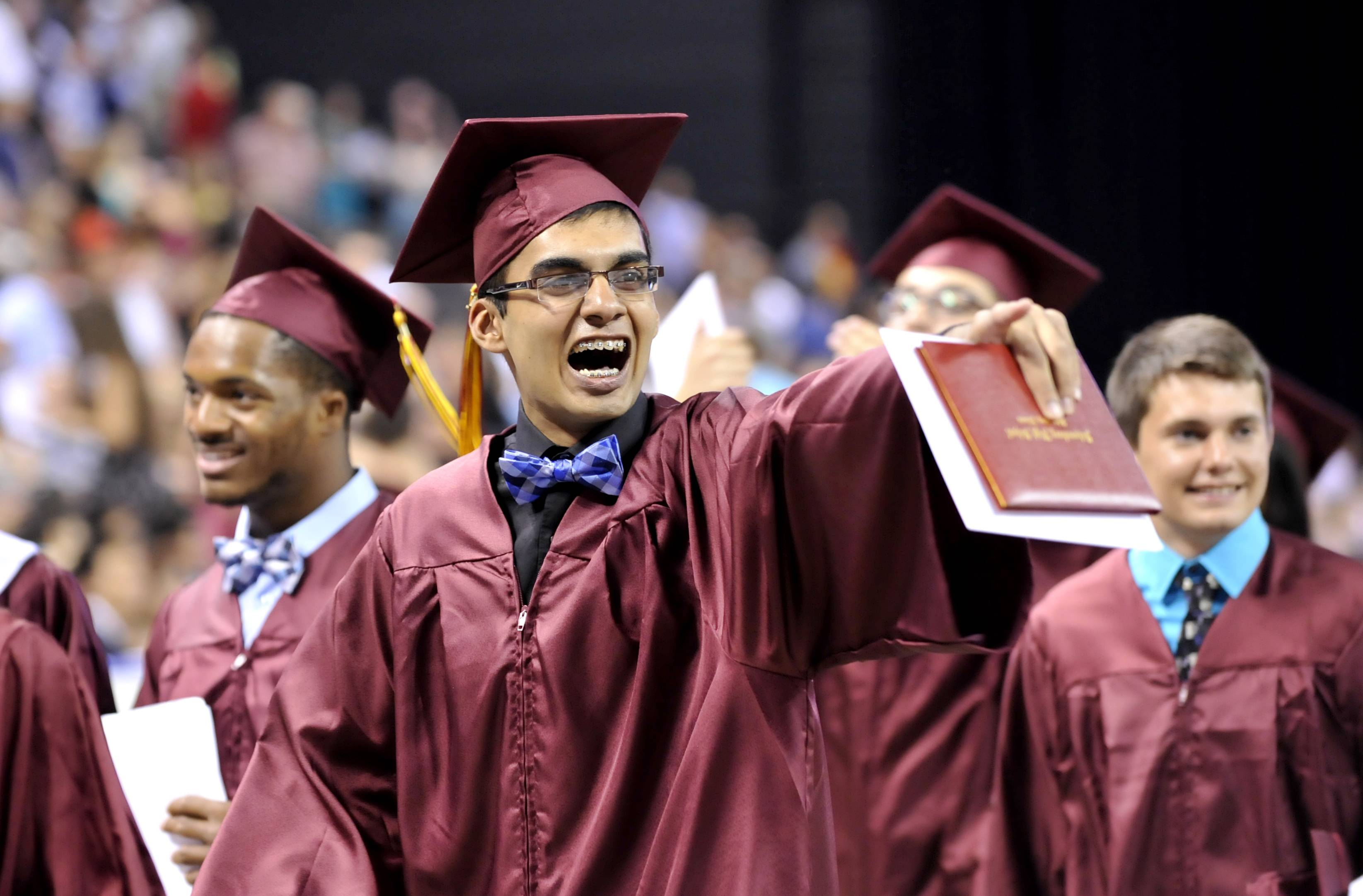 Param Patel cheers and yells at friends in the audience at the conclusion of the Schaumburg High School commencement at the Sears Centre in Hoffman Estates on Sunday, June 1.