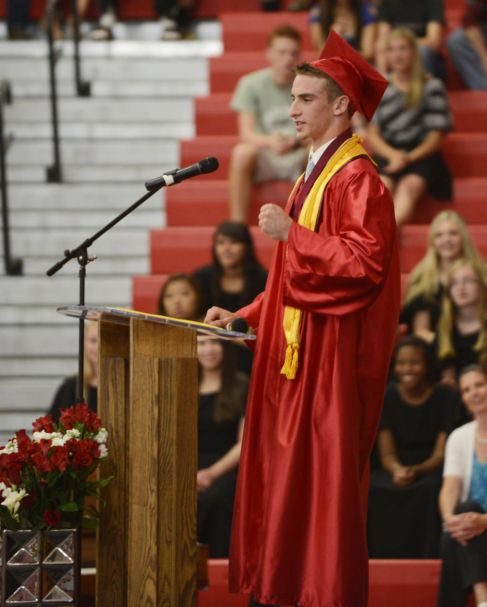 Valedictorian Patrick Cole speaks to his classmates at the Aurora Christian High School 2014 commencement ceremony Sunday in Aurora.
