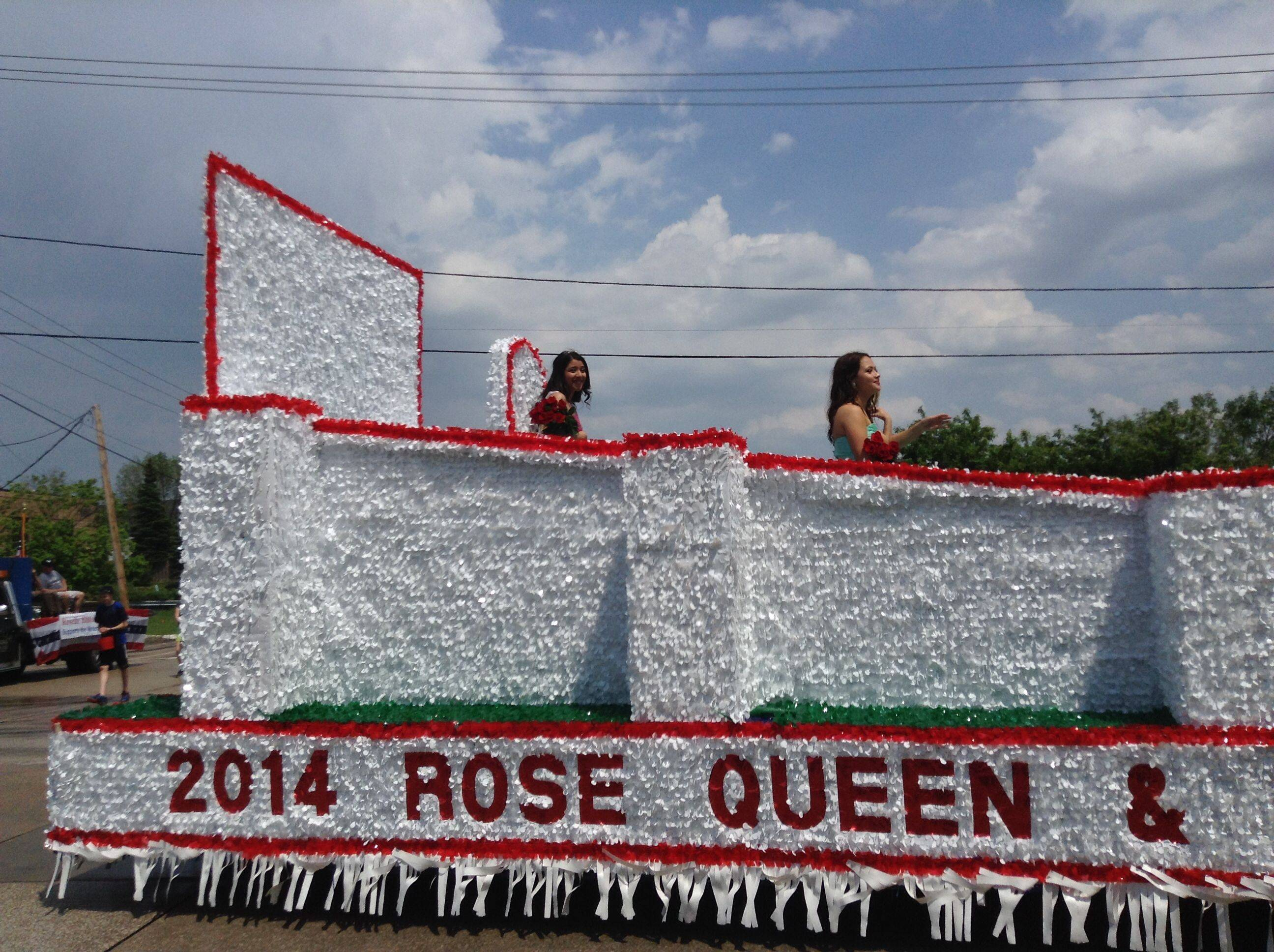 2014 Rose Queen Sharon Abraham, left, waves to the crowd Sunday as her float travels down the route of 55th annual Rose Parade in Roselle.