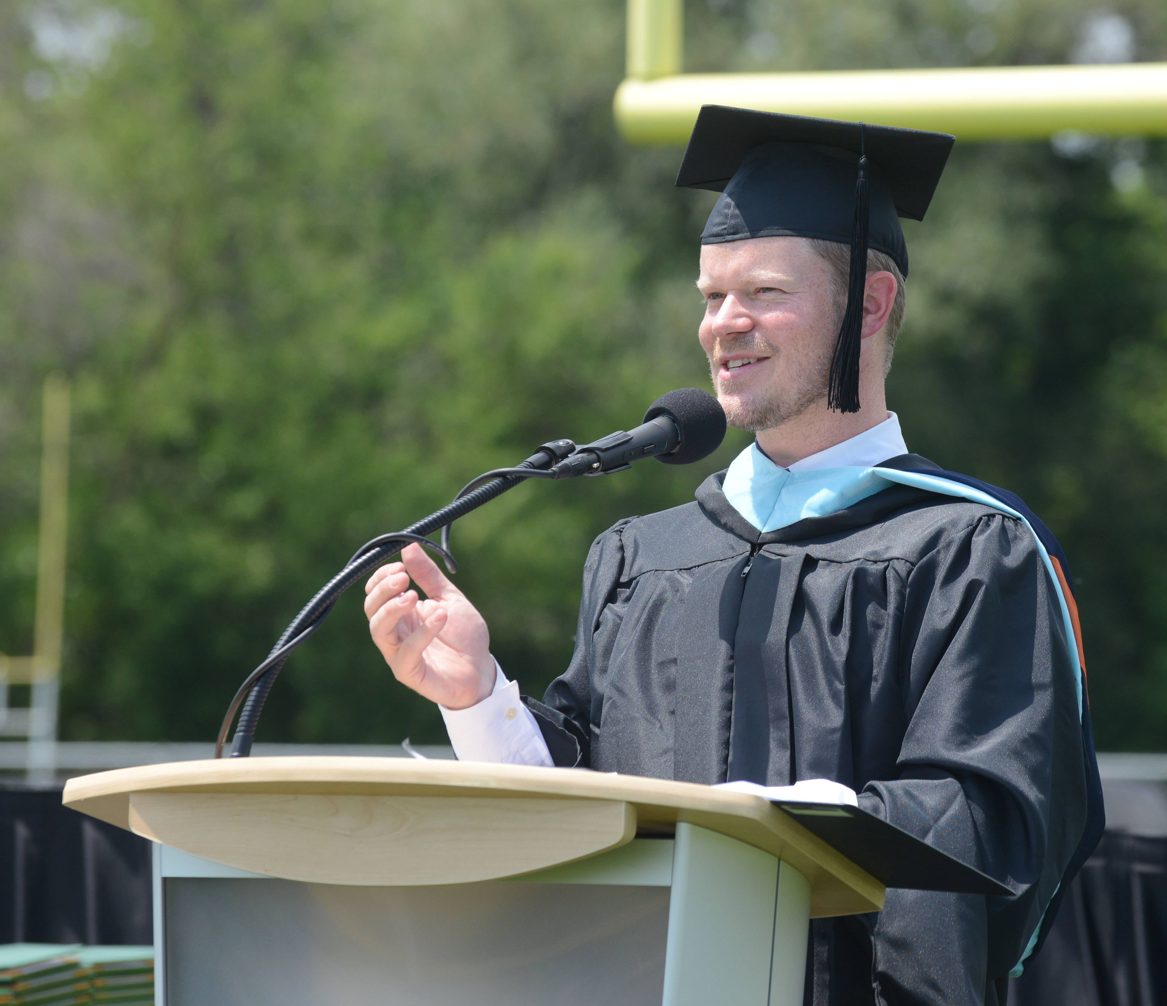 Principal Paul Kelly address the students and guests during the Elk Grove High School graduation Sunday.