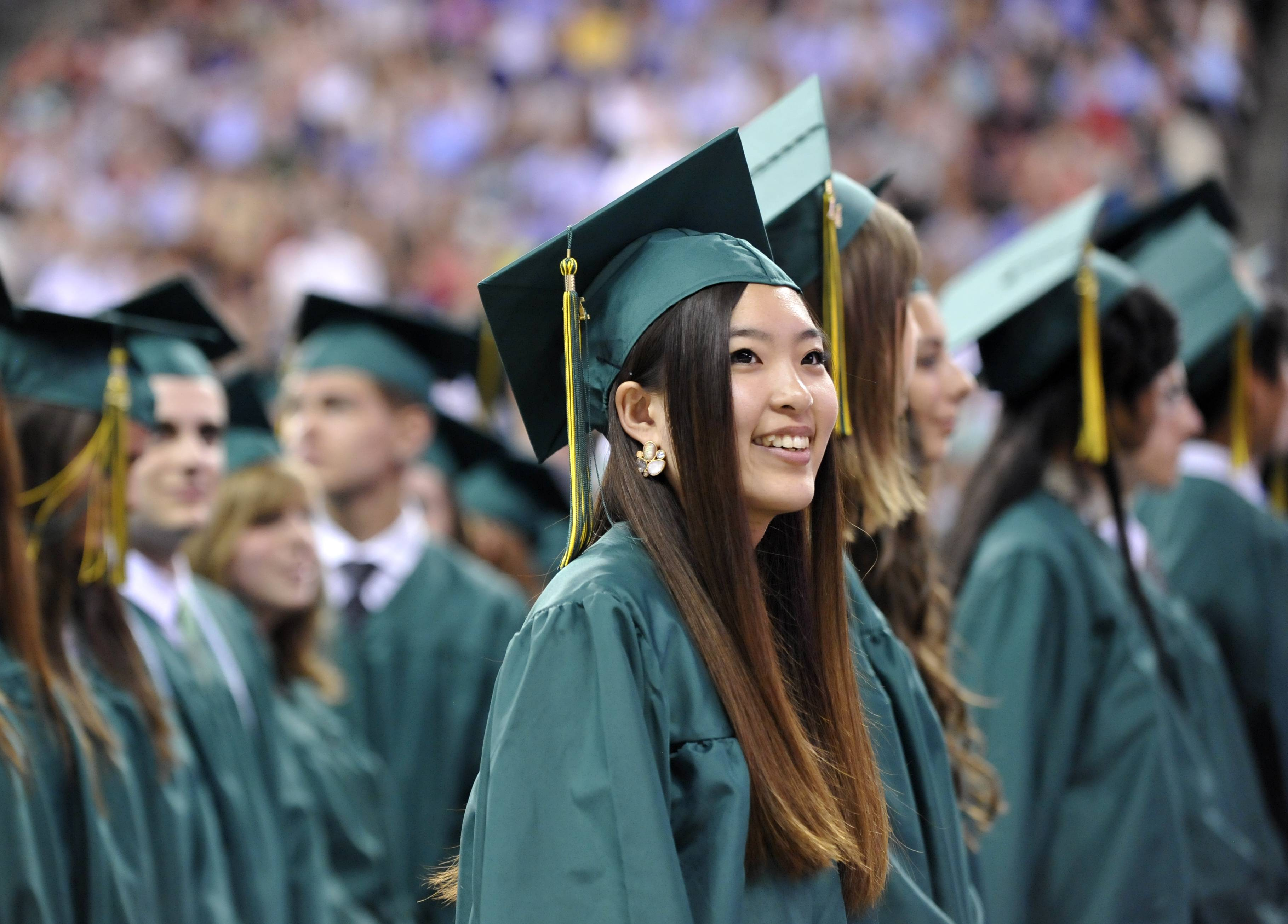 Mio Kurihara of Hoffman Estates glances into the audience at the start of the William Fremd High School commencement at Sears Centre in Hoffman Estates on Sunday, June 1.